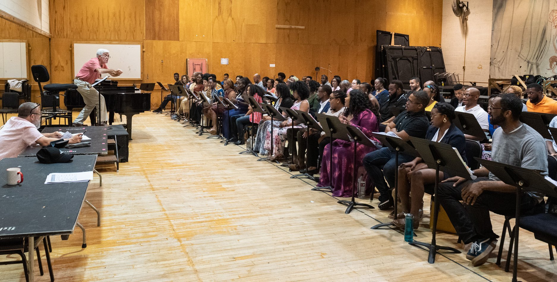 A Porgy & Bess room rehearsal with chorusmasters Donald Palumbo (at the podium) and Daniel Moody. (Photo: Jonathan Tichler)