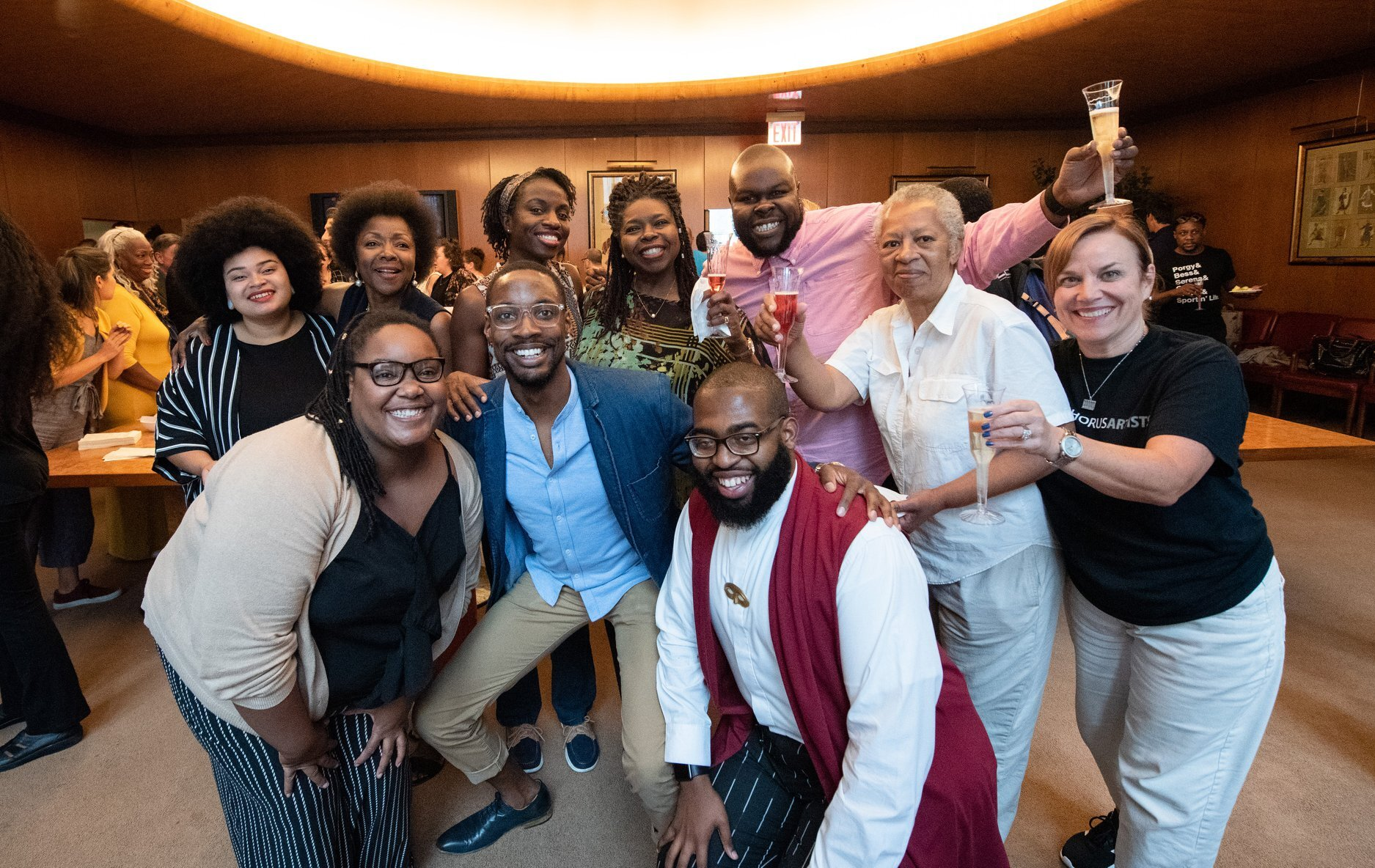 Members of the full-time Met chorus mingle (and enjoy a fine fizzy beverage) with members of the Porgy chorus. (Photo: Jonathan Tichler.)