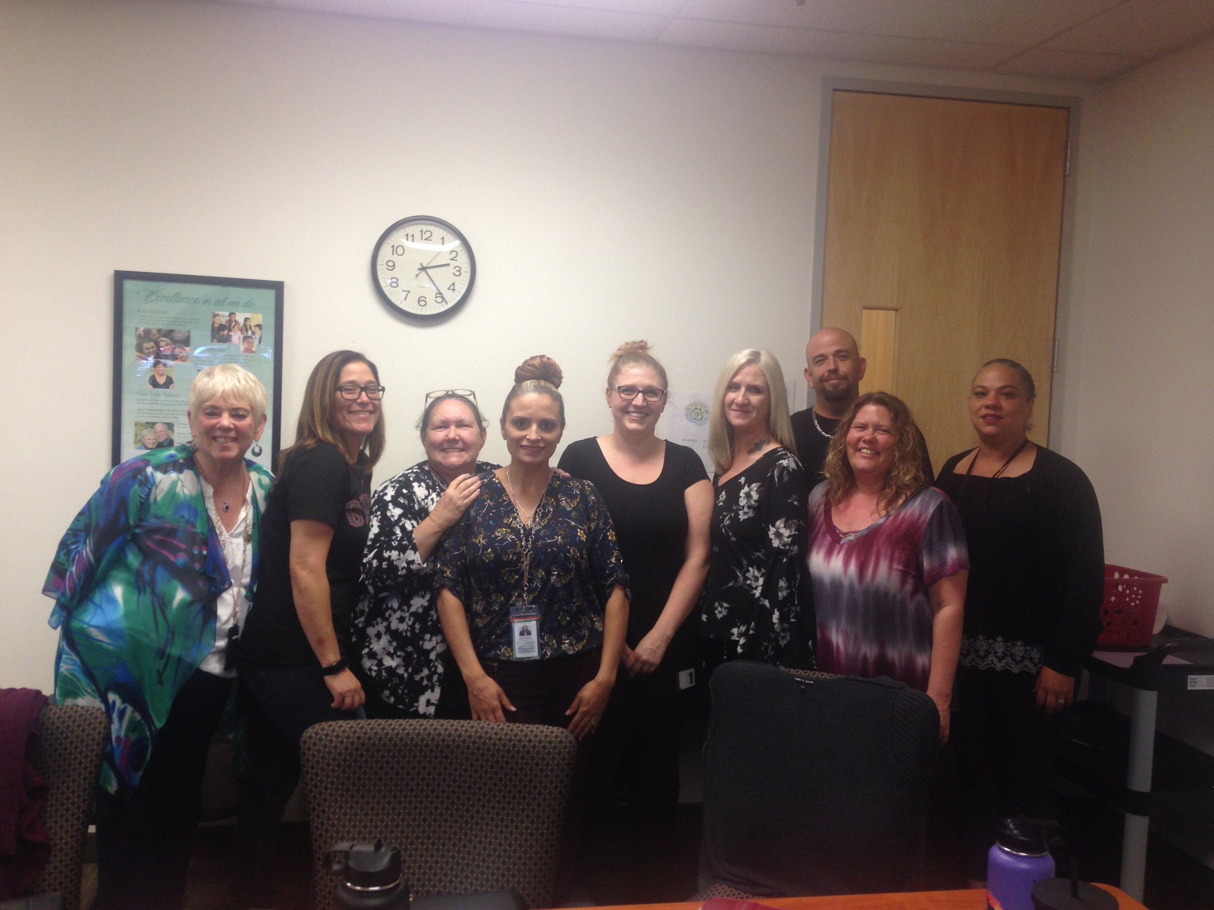 The family engagement unit in Contra Costa County, Northern California (Judi, Sunita, Cheryl, Joanie, Sarah, Gina, Dave, Heather and Melissa). The team is made up of 2 drug and alcohol peer mentors and the rest are parent partners - parents with a lived experience of child removal and successful restoration. The team is led by social worker Judi and they work directly with parents to support early and safe restoration.