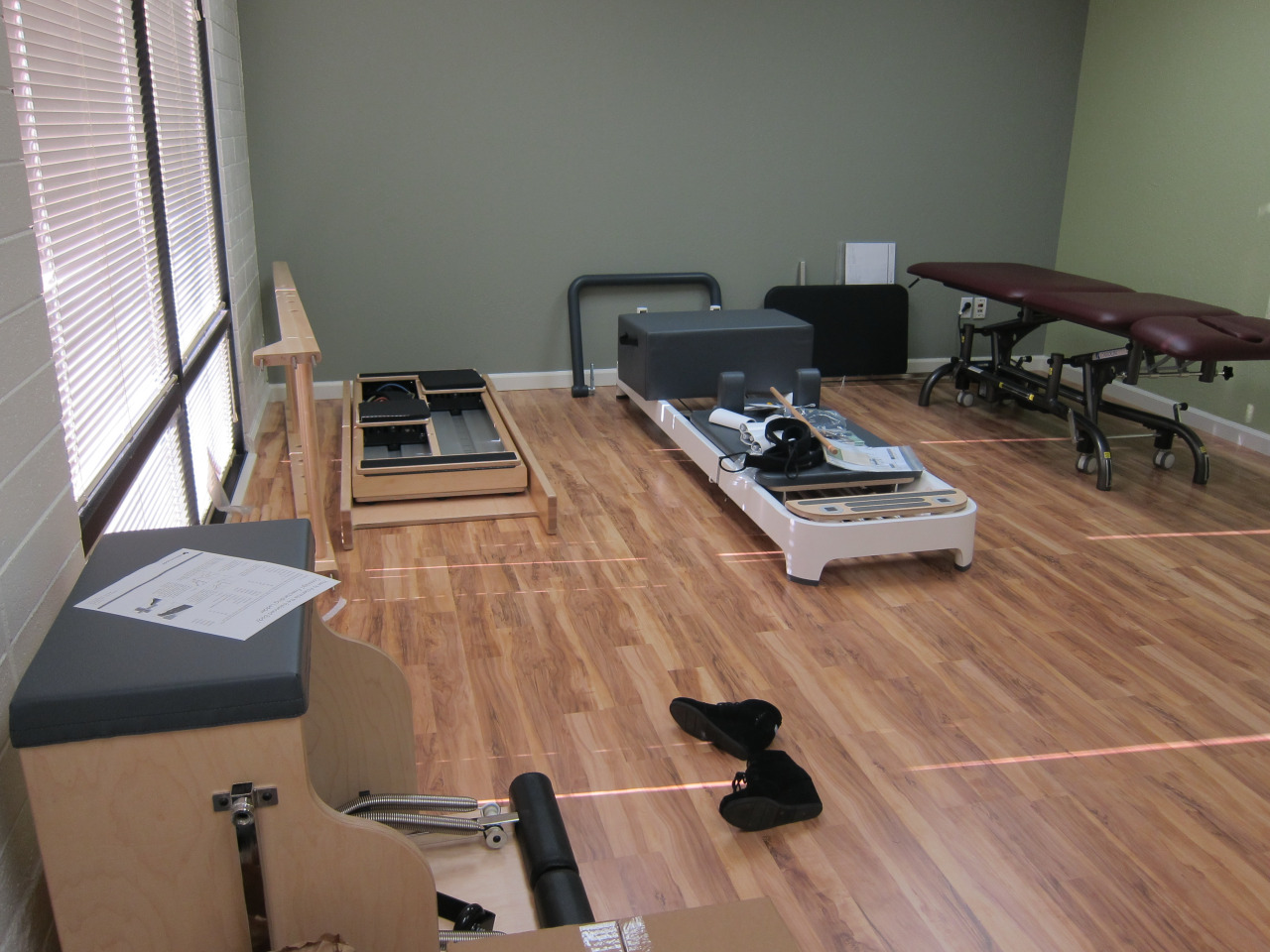 Pilates equipment came in!  The guys that delivered were so rough with everything.  They were tossing boxes around (almost hit my daughter with a flying box), dropped some stuf,f scuffed my wall, and almost fell.  It was scary to watch.  We were lucky that we were able to meet them too.  They were supposed to come between 8:30 and 1:30 .. of course they arrived at 1:45.     High-low table came in on the same day.  I wasn't going to get one but I found a good deal on a very, very gently used table.  I had to just accept that it was going to be burgundy.  I would have chosen grey.  Oh well, at least it's a color that matches.     Now it's time to assemble everything.  The brothers are coming this weekend to help me assemble the ikea furniture and all the pilates equipment.