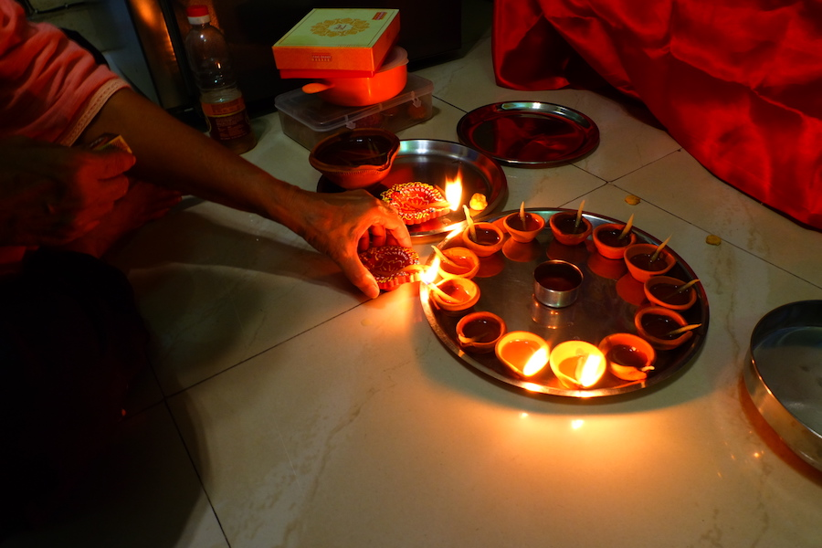Maasi lighting diyas for our  Lakshmi  - goddess of wealth and prosperity - puja