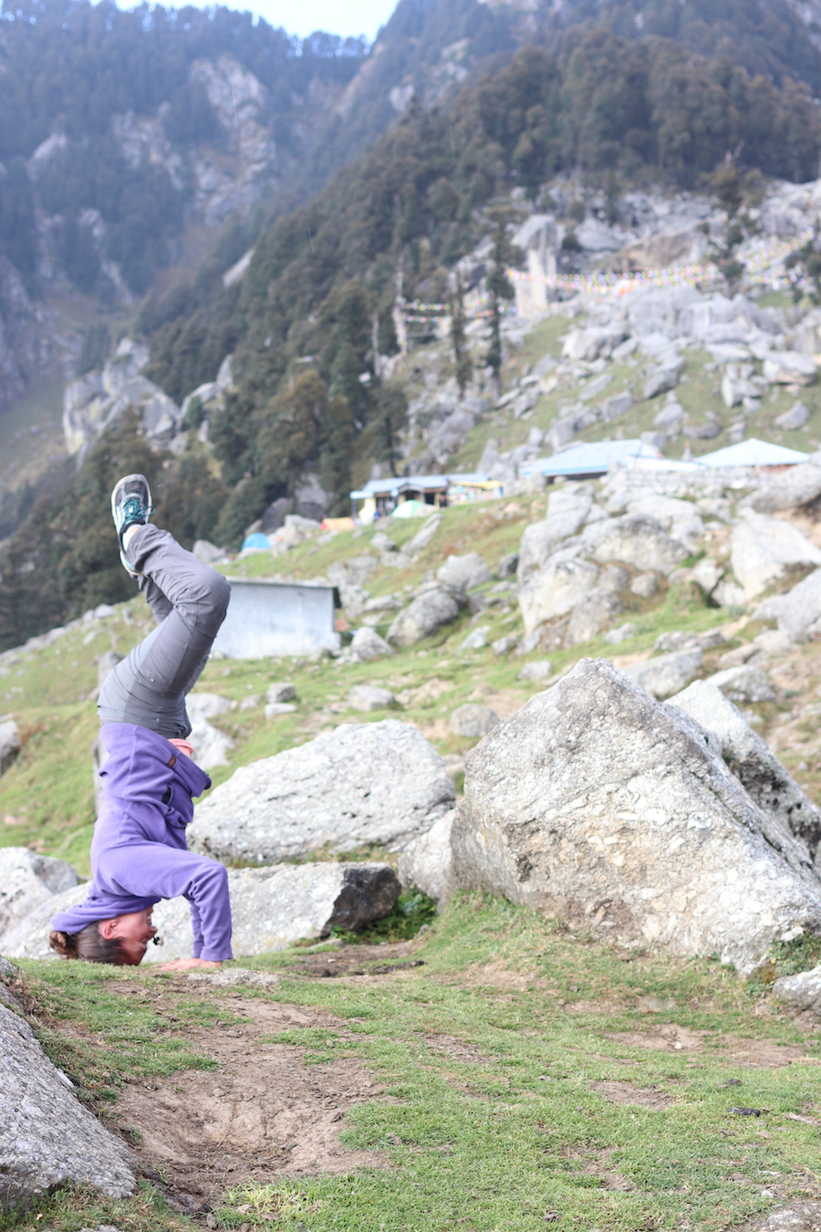 Our new friend Marnie - whom we met on the bus -doing some post-snack headstands at Triund. We feasted on some moong dal and chai in one of the stalls found at the top while I recovered from altitdude sickness.