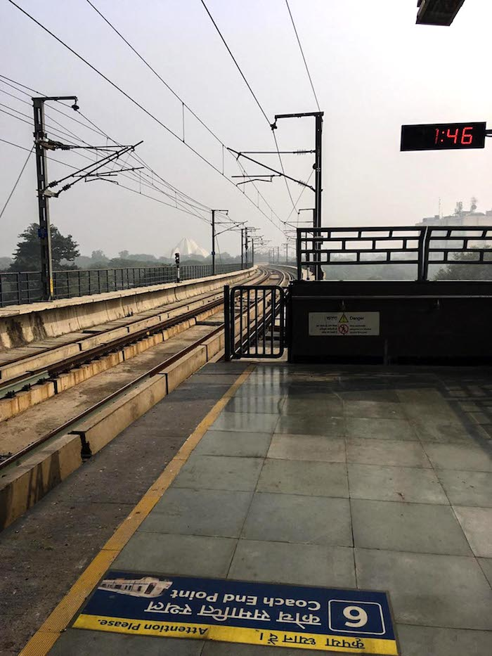 Nehru Place Metro Station two weeks later (notice how visible the Lotus Temple is to the left of the tracks).