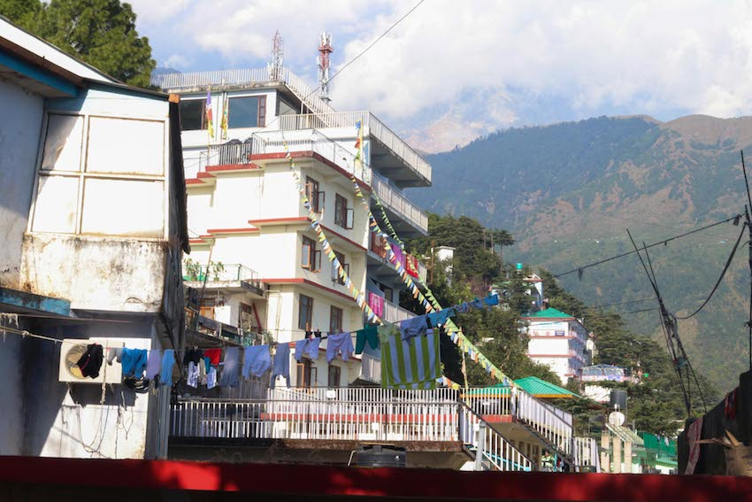 Laundry and prayer flags hang in Dharamsala.