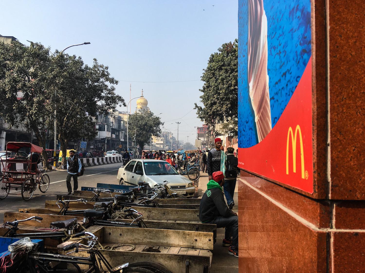 Ah yes, some authentic Old Delhi street food, Mickey Ds, with Gurudwara Sis Ganj Sahib in the background.