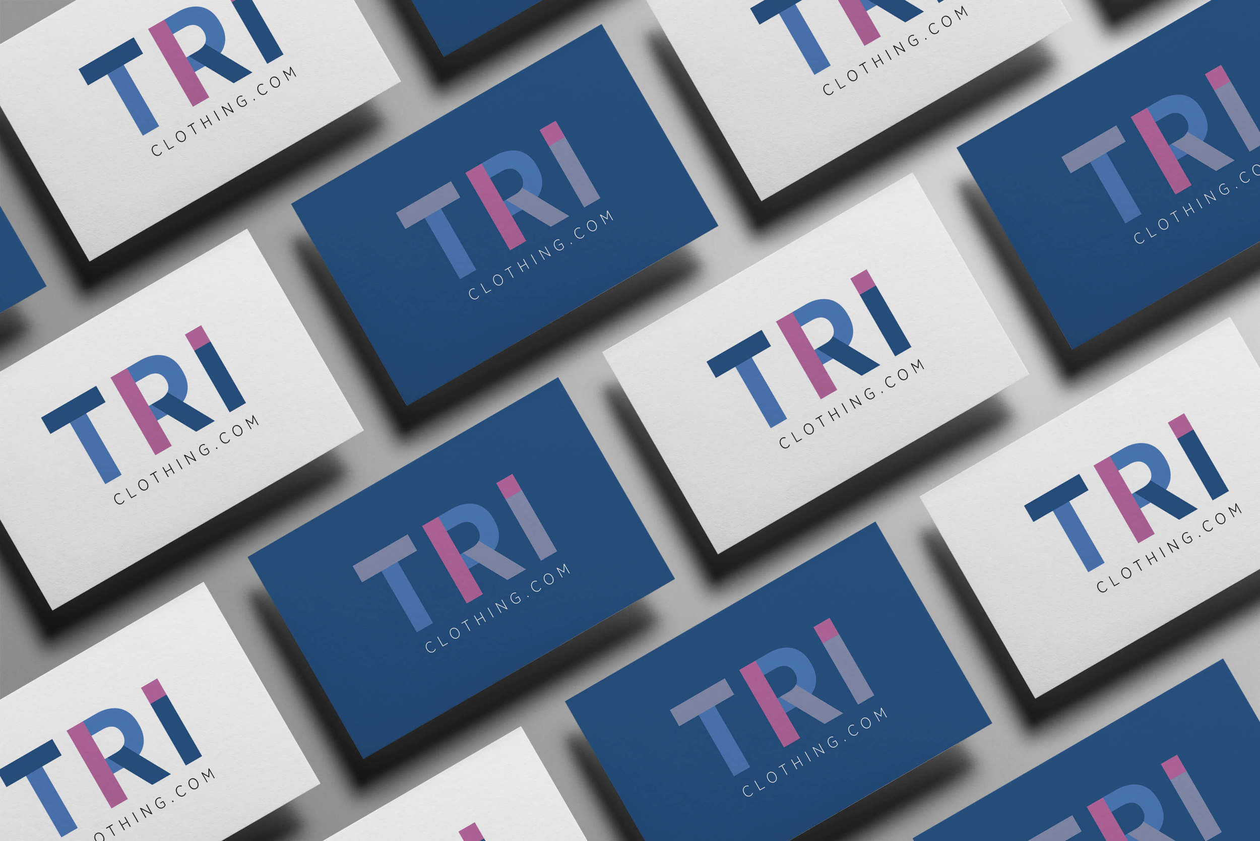 Create Onsight's design of various business cards and company logo for TRI Clothing
