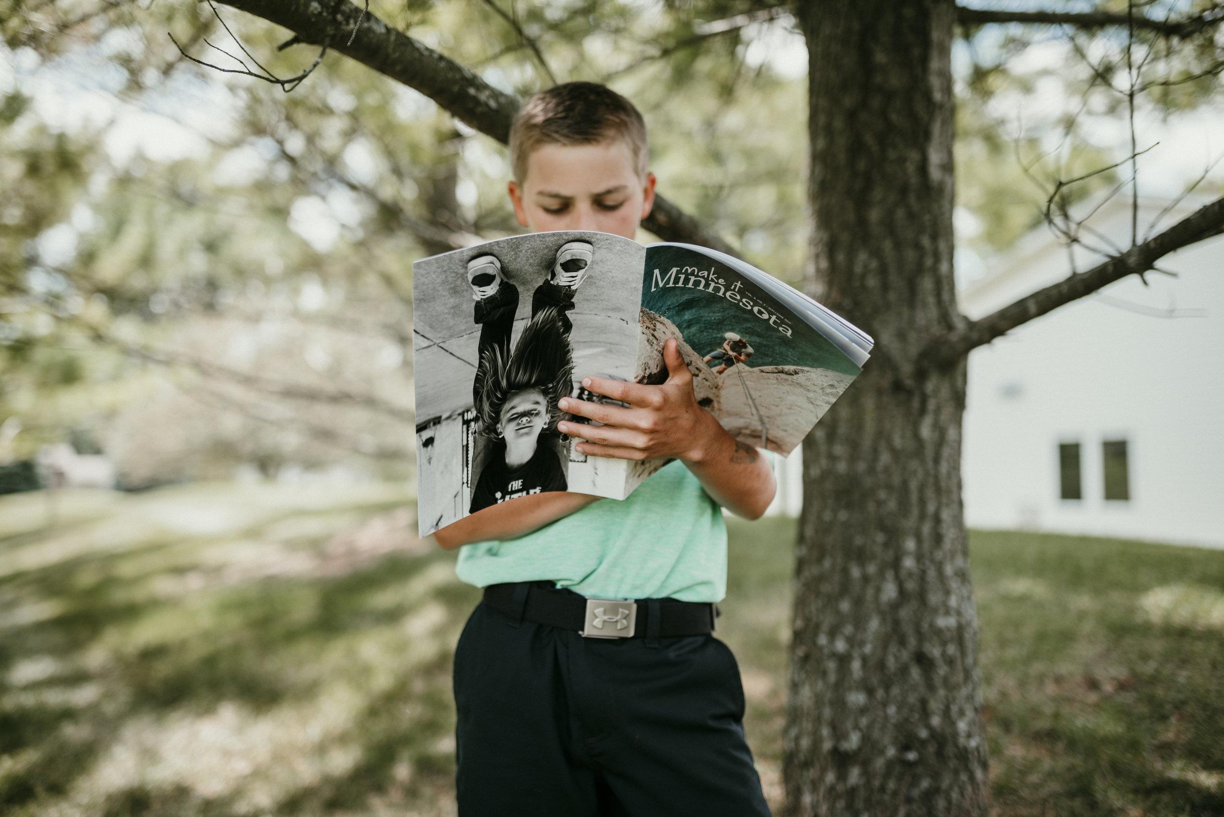 reading magazine outside