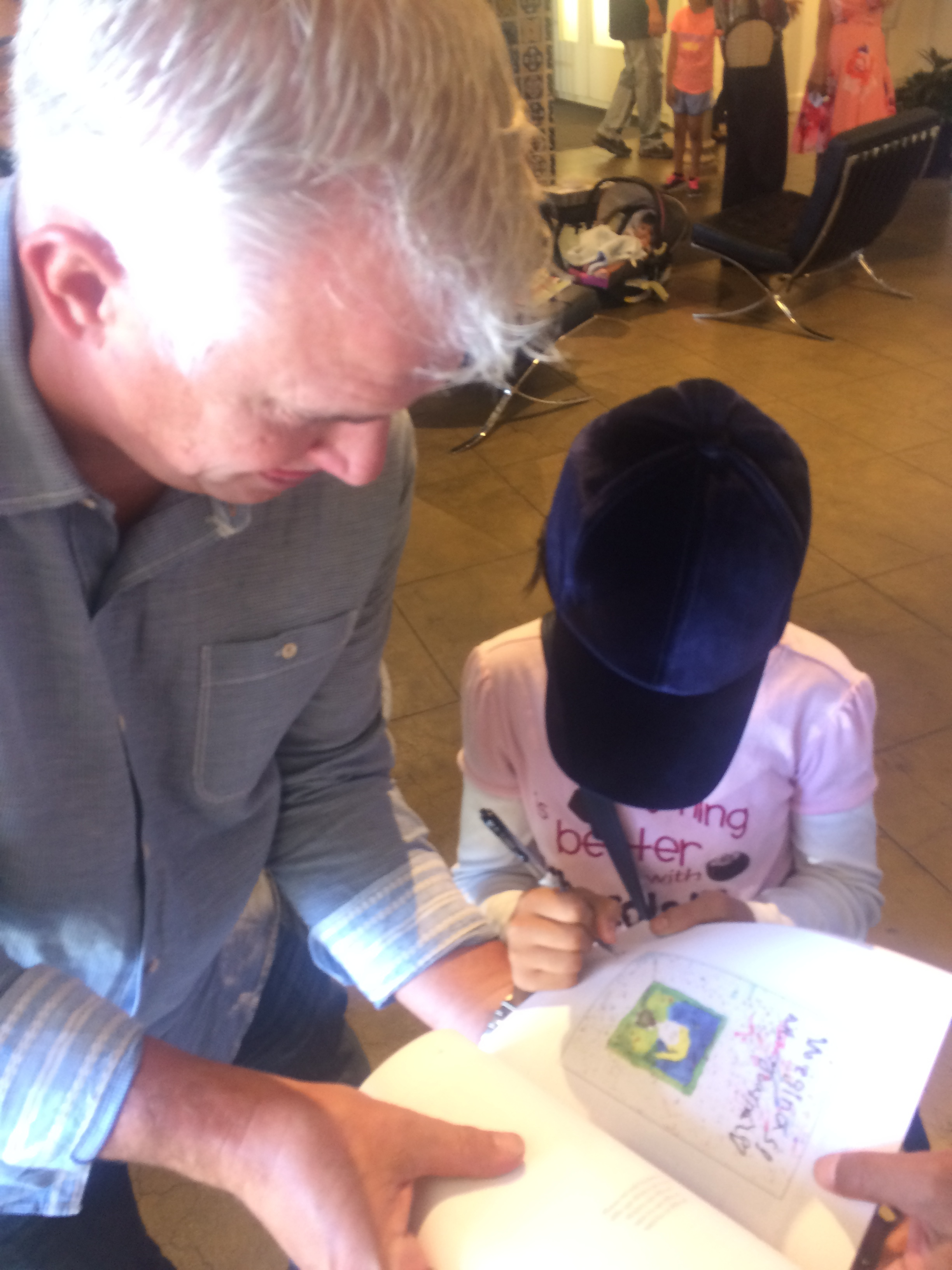 Poet signing a book