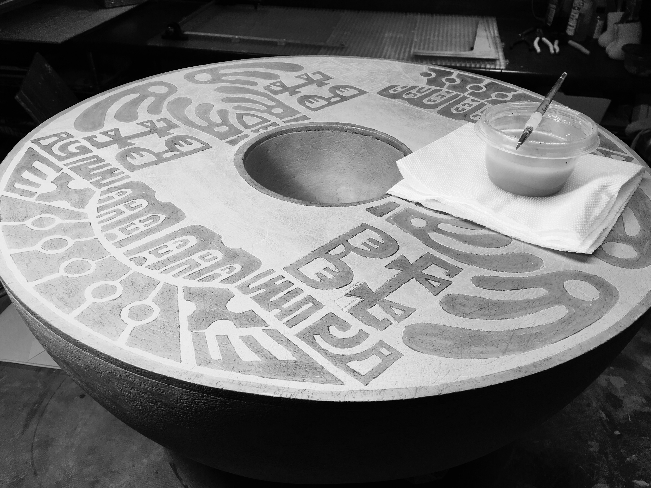 Shellac design is brushed on before sponging relief design