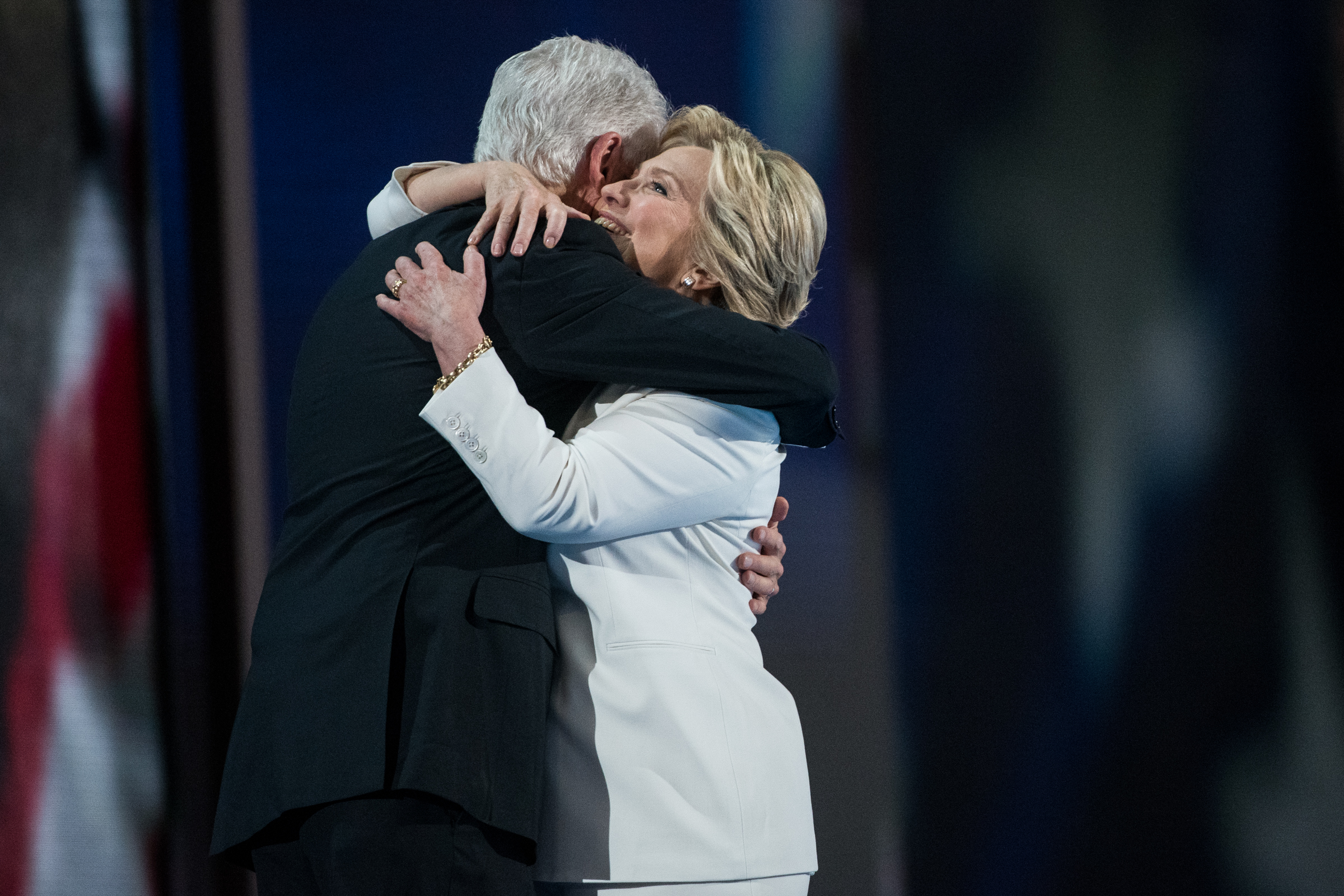 Democratic presidential nominee Hillary Clinton hugs former president Bill Clinton at the Democratic National Convention inside the Wells Fargo Center in Philadelphia on Thursday July 28, 2016. (Michael Ares /Philadelphia Inquirer)