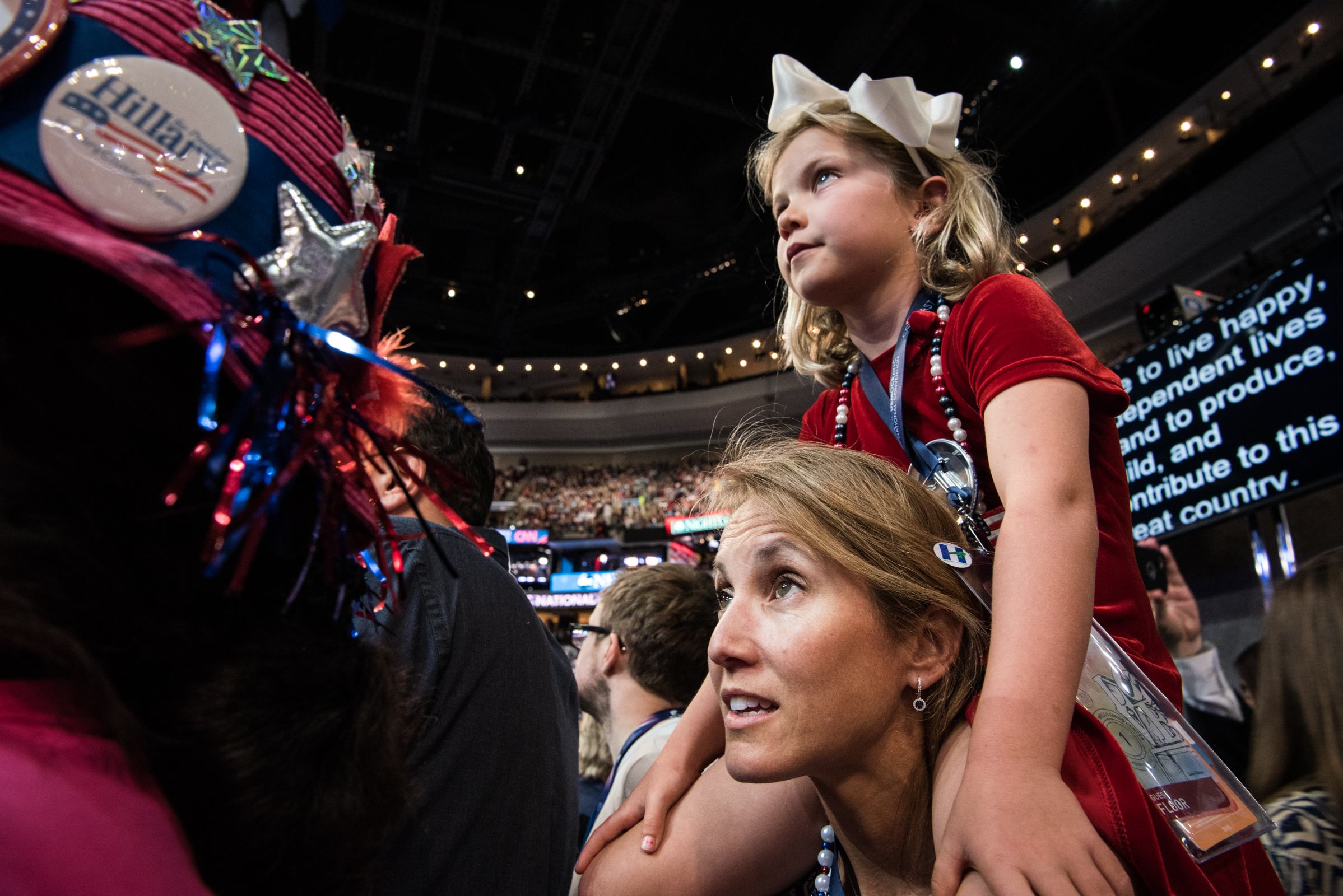 Tracey Turner of California holds her daughter Somerset, 6, upon her shoulders so she could be able to view the Democratic National Convention from the floor level at the Wells Fargo Center in Philadelphia on Monday, July 25, 2016. (Michael Ares / Philadlephia Inquirer)