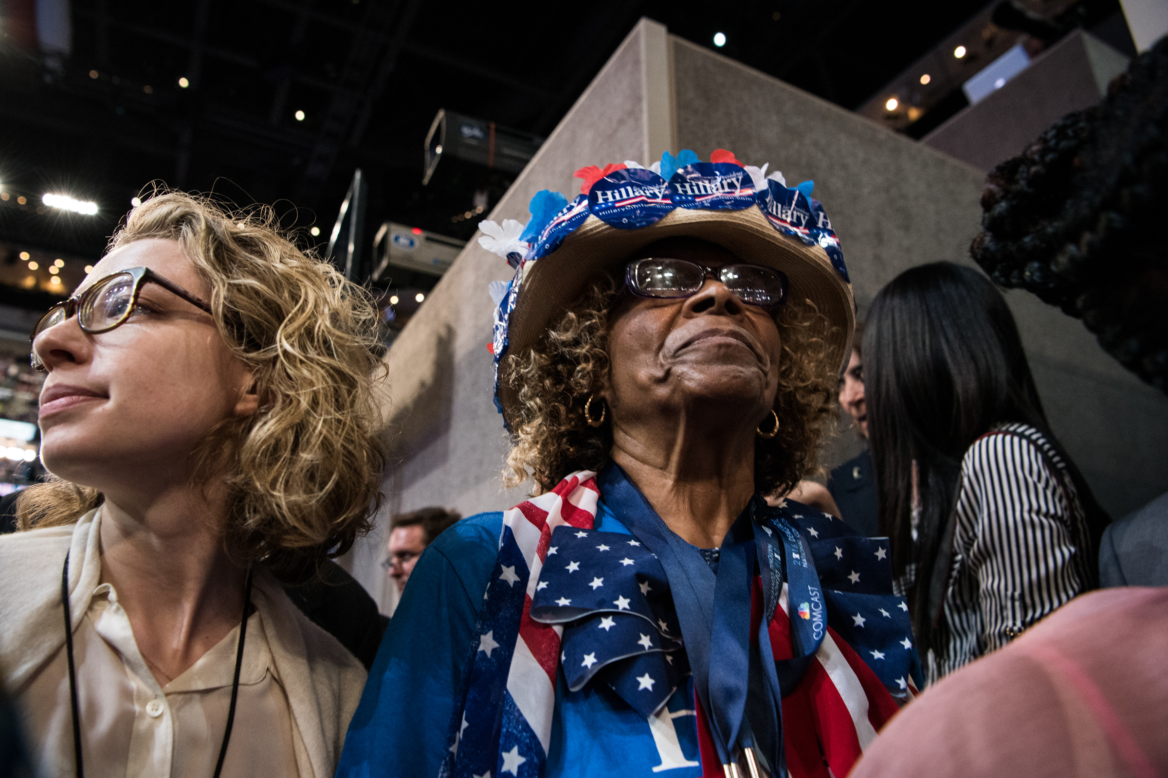 Gladys Evans (center) of Florida dons a Hillary Clinton themed hat during the Democratic National Convention at the Wells Fargo Center in Philadelphia on Monday, July 25, 2016. (Michael Ares / Philadelphia Inquirer)