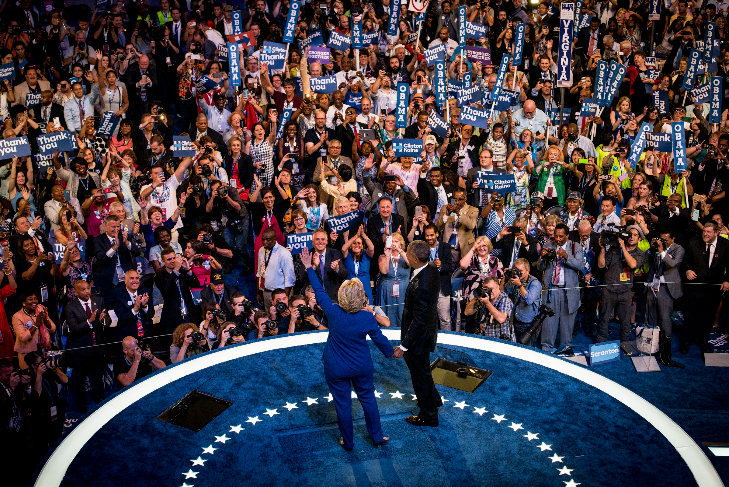 Democratic presidential nominee Hillary Clinton walks on to the platform with President Barack Obama after his speech during the Democratic National Convention at the Wells Fargo Center in Philadelphia on Wednesday July 27, 2016. (Michael Ares / Philadelphia Inquirer)