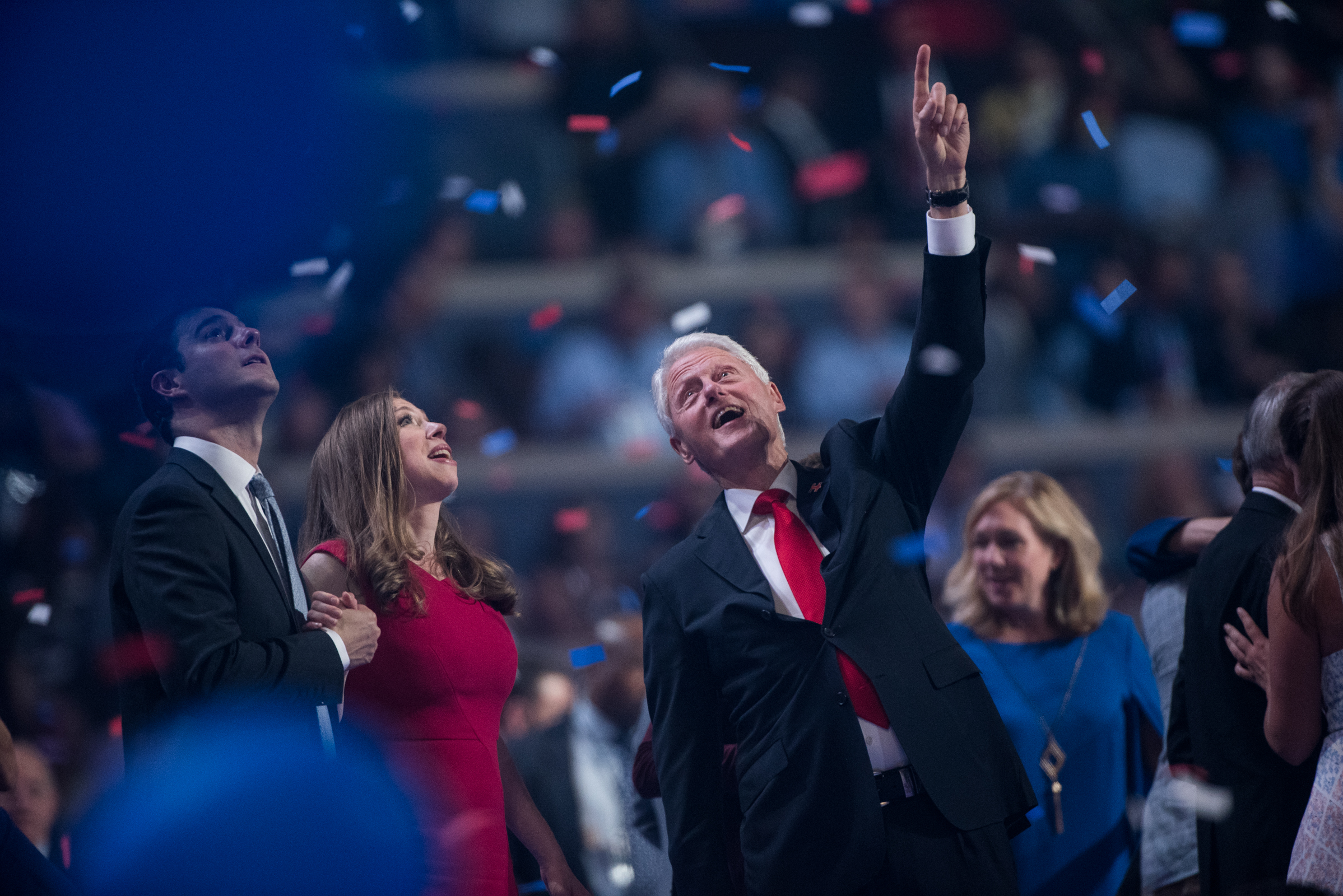 Former president Bill Clinton points to balloons released at the end of the Democratic National Convention inside the Wells Fargo Center in Philadelphia on Thursday July 28, 2016. (Michael Ares /Philadelphia Inquirer)