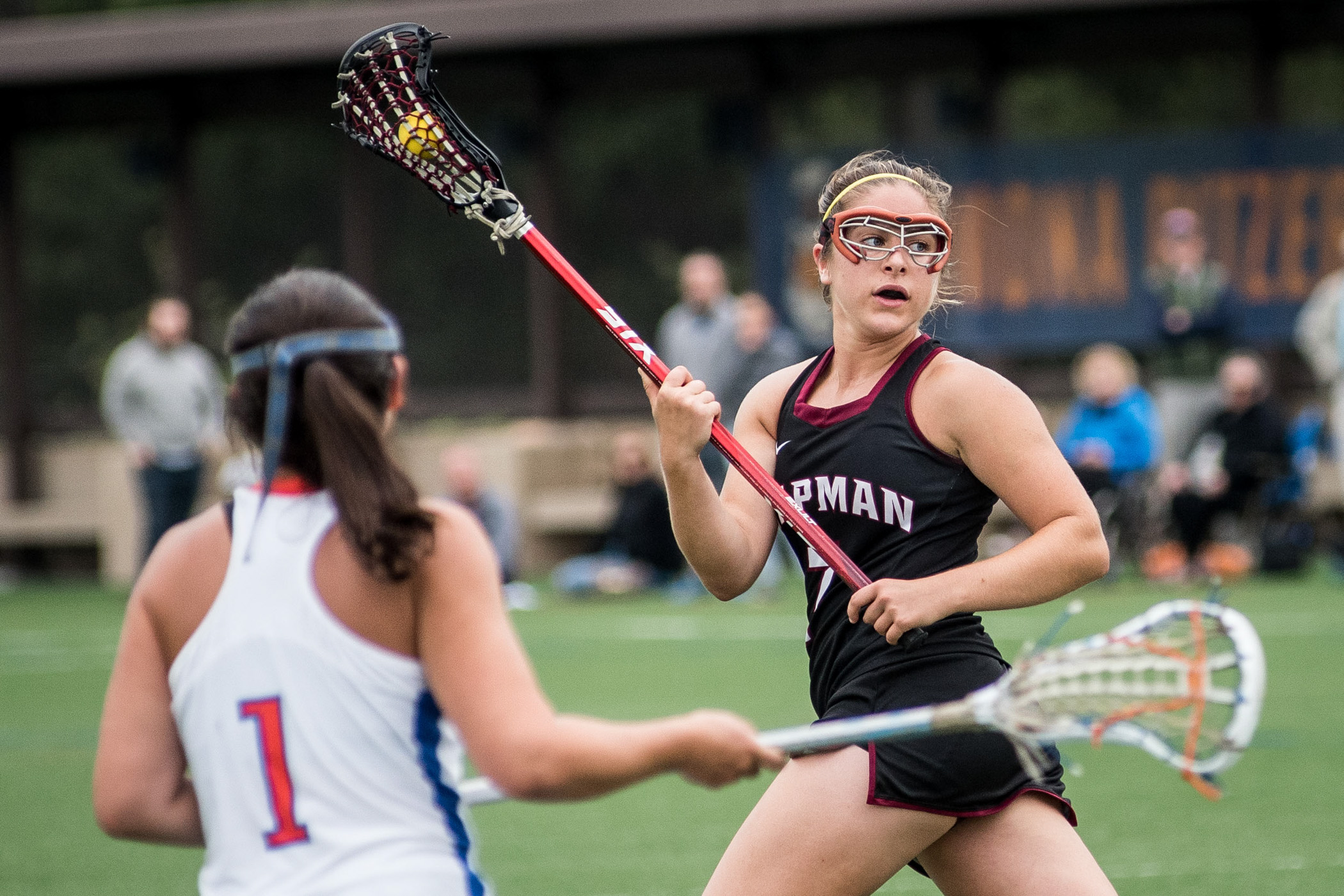 Chapman University's Kelsey Mackin brings the ball up the field against Pomona-Pitzer's Katie Savino during the second round of the Division III NCAA women's lacrosse tournament in Claremont, Calif.,on Sunday, May 15, 2016. (Michael Ares, Contributing Photographer, Orange County Register)