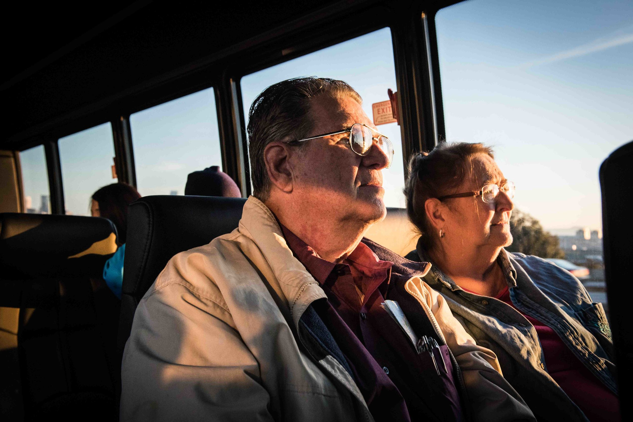 "Santa Ana resident, Douglas Chapman, left, and his wife Sue ride on a bus to the Triton Museum of Art on Saturday, Feb. 7, 2016 in Santa Clara, Calif., where the Pro Football Hall of Fame's ""Gridiron Glory"" exhibit was featured. Chapman bought a scratchers ticket for the $10-million dollar lottery and did not win, but entered into the 2nd Chances program with the California Lottery and won a five day all expenses paid trip for two to Super Bowl 50 in the San Francisco Bay Area. (Michael Ares, Contributing Photographer, Orange County Register)"