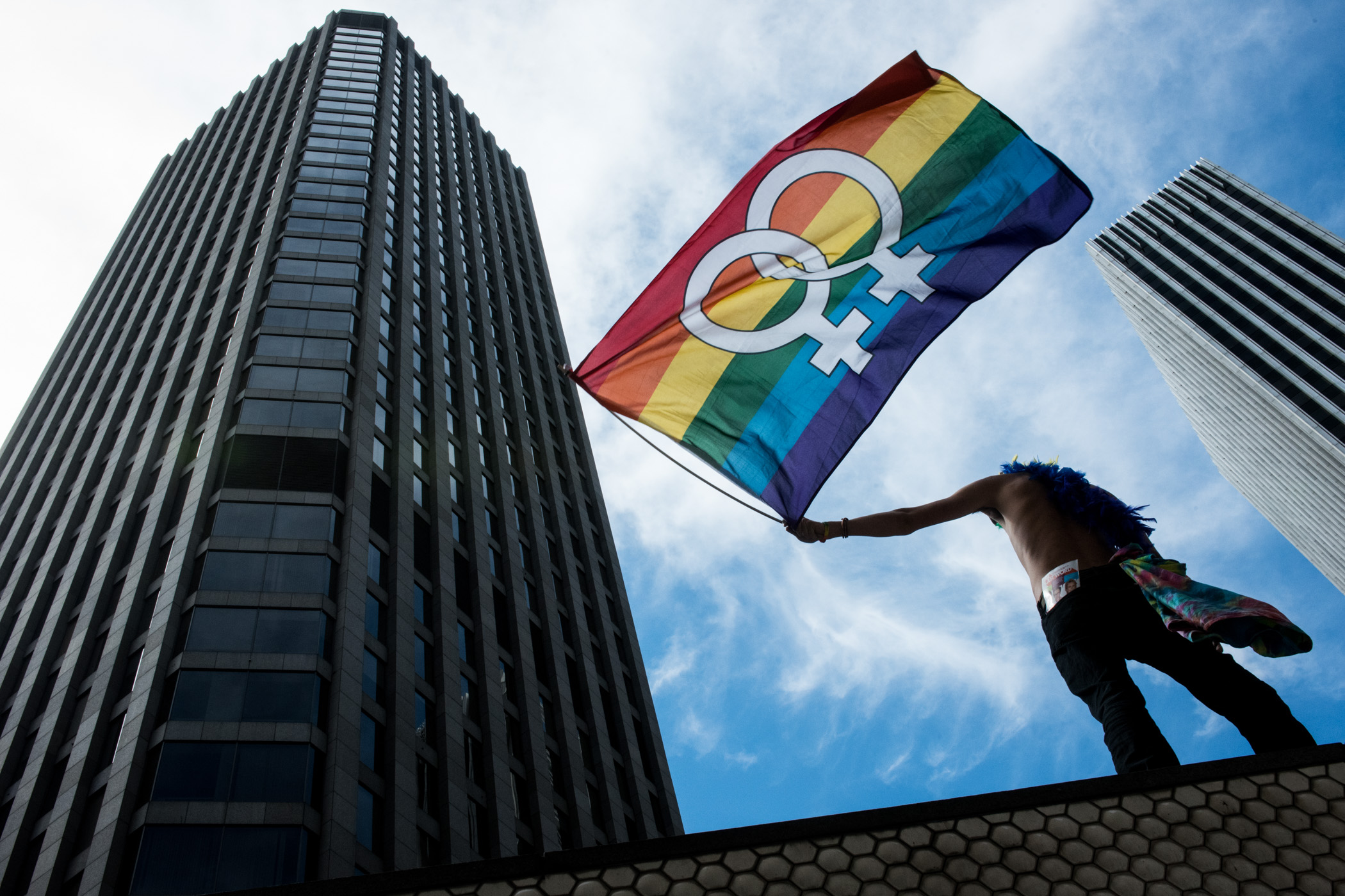 Napa Valley resident, Daniel Leonie, waves a Gay Pride flag during the San Francisco Pride event on Sunday, June 28, 2015. (Michael Ares / Special to the S.F. Examiner)