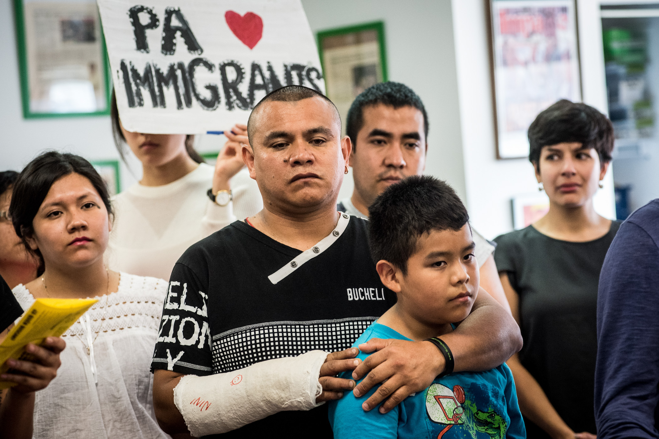 Carlos Rojas holds son Michael, 11, during a news conference in Philadelphia at which activists and immigrants voiced their opinions on the 4-4 Supreme Court ruling on Thursday, June 23, 2016. As an unauthorized immigrant Rojas was affected by the Supreme Court's decision on the Deferred Action for Parents of Americans program which protected him from deportation and allowed him to work legally. (Michael Ares / Philadelphia Inquirer)