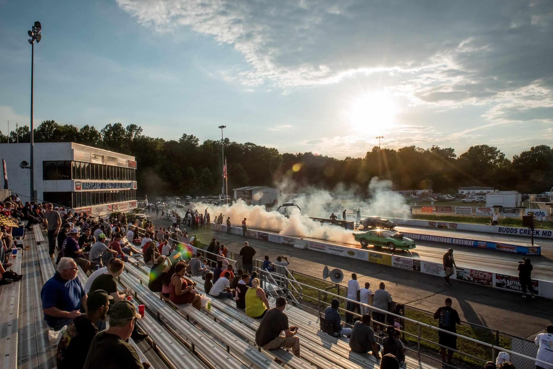 Crowds watch cars race from the stands during the War On Wheels event at the Maryland International Speedway in Mechanicsville, Md., on Wednesday, June 21, 2017. (Michael Ares / The Baltimore Sun)