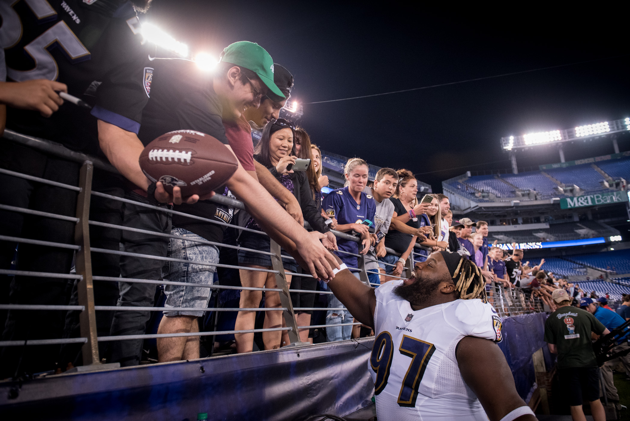 Baltimore Ravens defensive tackle Michael Pierce #97 interacts with fans after a preseason game against the Washington Redskins at M&T Bank Stadium in Baltimore on Thursday, Aug. 10, 2017. The Ravens defeated the Redskins 23-3. (Michael Ares / The Baltimore Sun)