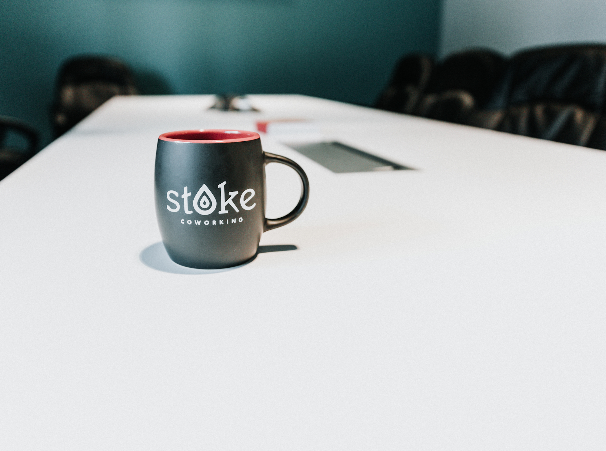 Stoke coworking mug in conference room 3.jpg