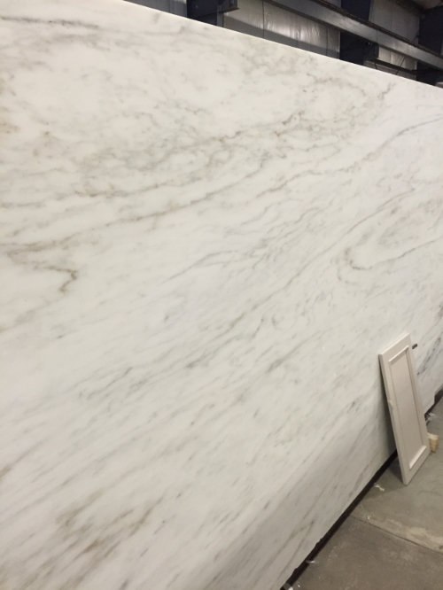 One of our Imperial Danby marble slabs in the warehouse with one of our cabinet doors. Danby marble is quarried in Vermont, and it's the same marble used in Arlington National Cemetery. Who doesn't like cemetery marble?