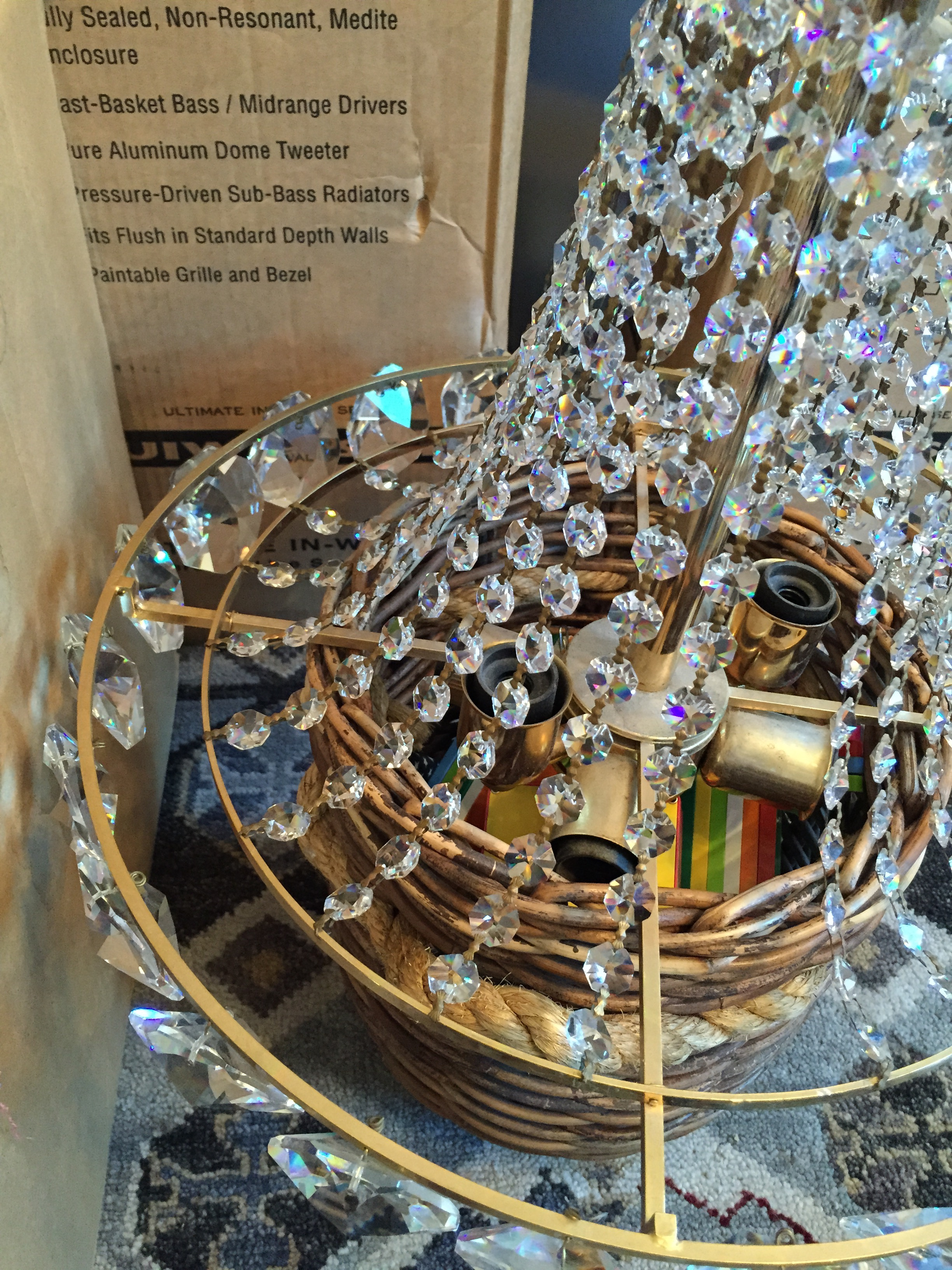 The cleaned upper portion of the chandelier, resting on top of a basket of Magna-Tiles, of course. (Best toy ever!)