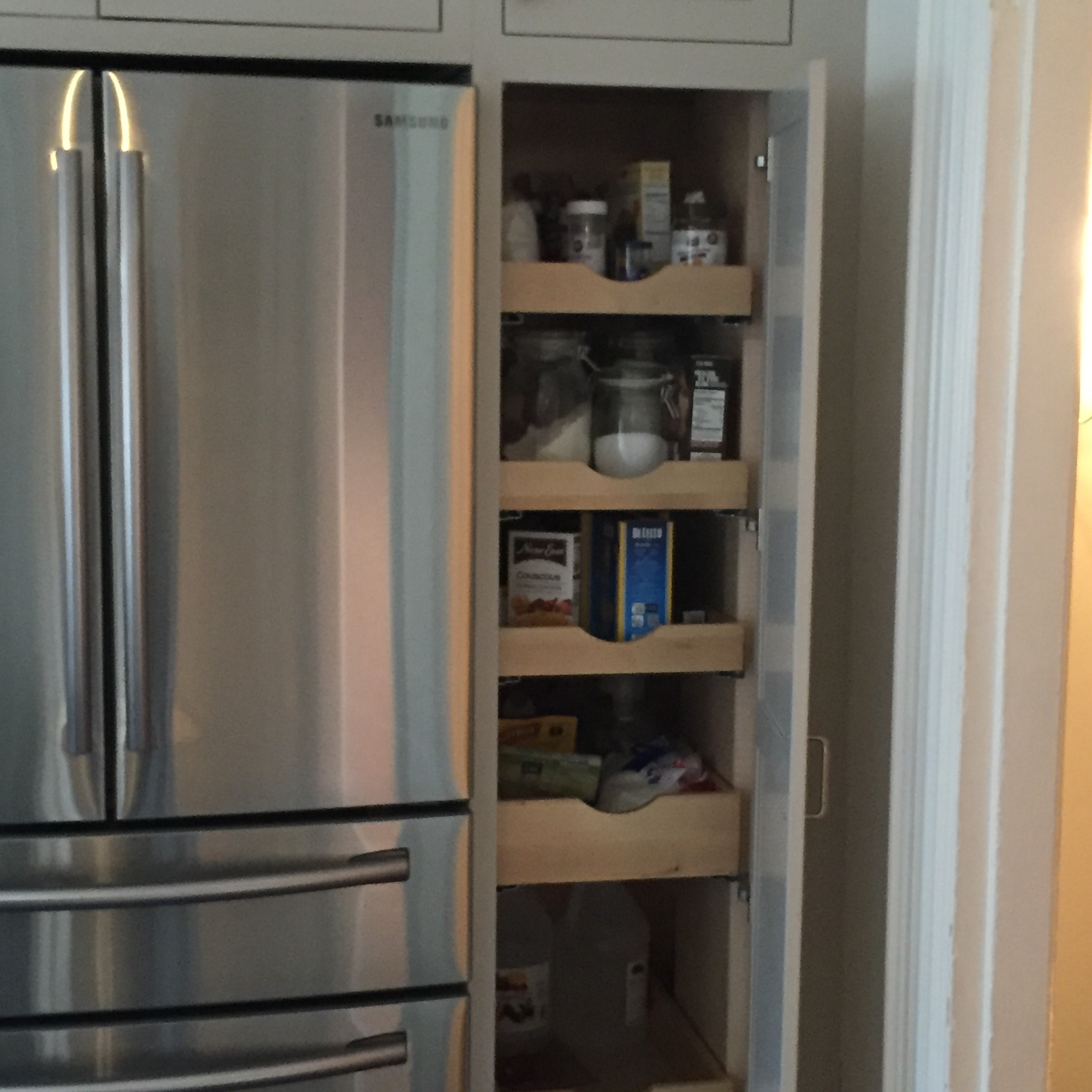 Roll-out pantry shelves