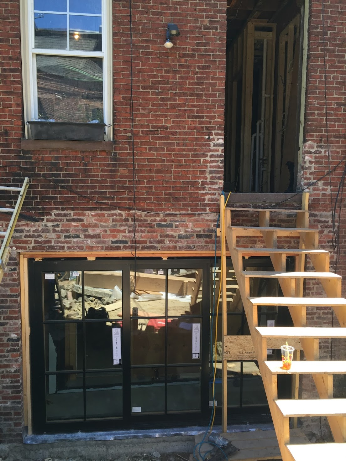 The La Cantina doors in place. Check out the nifty staircase the contractors built so they could get in and out of the kitchen, eliminating the need to track in and out of our living space.