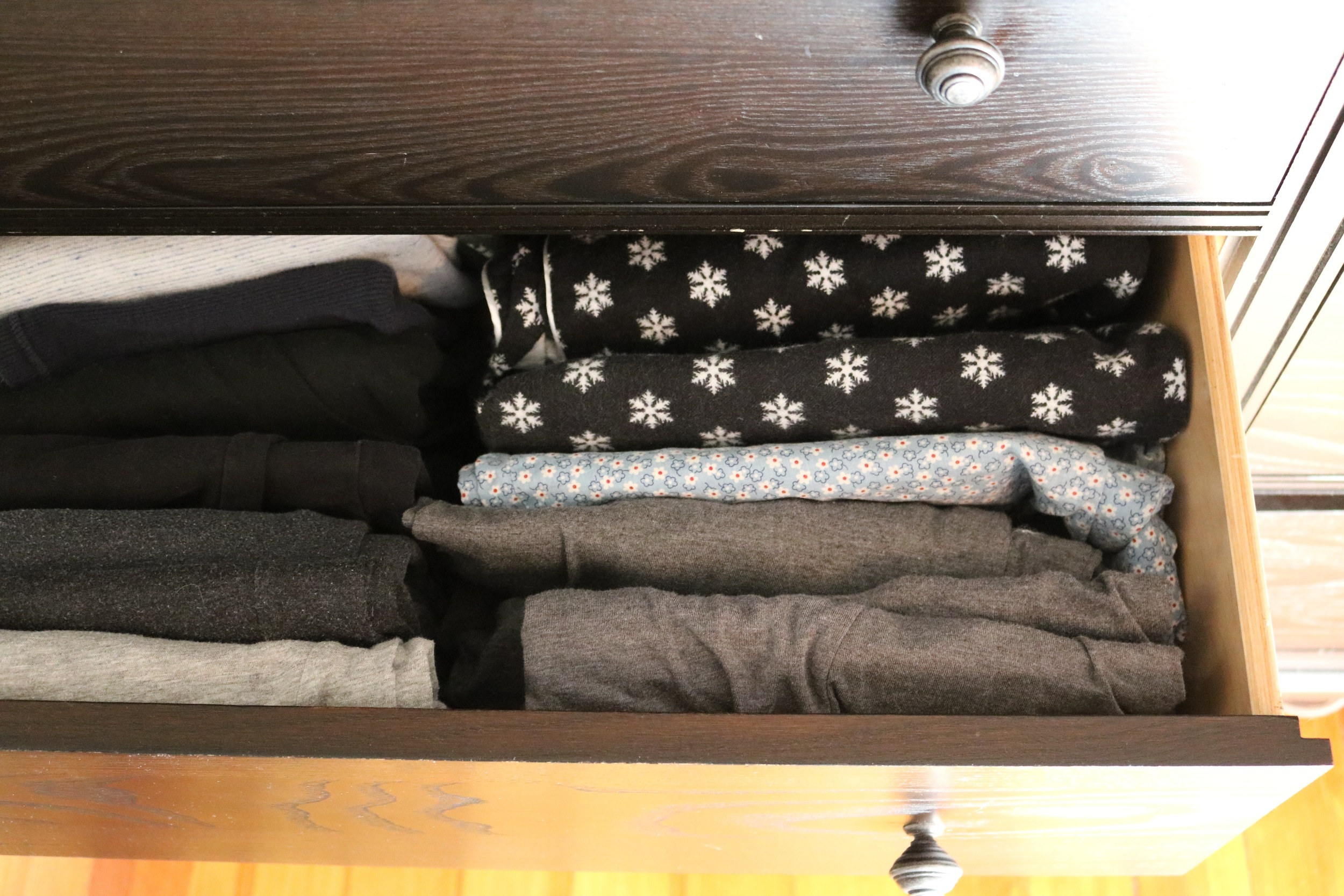 Vertically-filed pajamas and loungewear, post-Kondo purge.