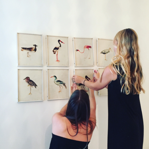 My colleagues setting up the gallery wall in Jessie's daughter's room.