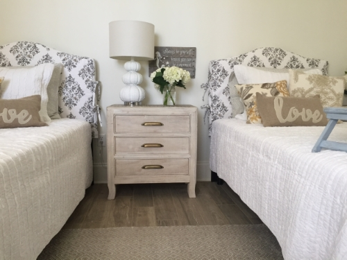 Our finished look for daughter Vivianne's room. These beds were supposed to be assembled on set by two brawny handymen with power tools. Which ended up being me and my jumpsuit-clad colleague Keriann and two Allen wrenches. Turned out great, though!