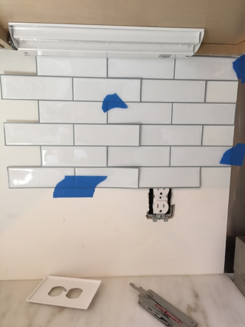 Aligning the peel-and-stick tiles