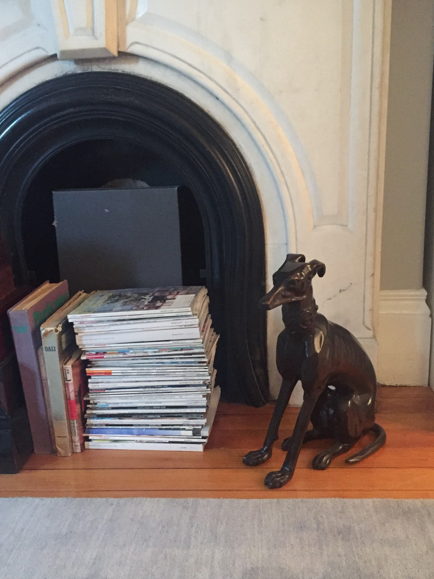 Or, in the case of the bedroom mantel, they're unread-magazine storage.