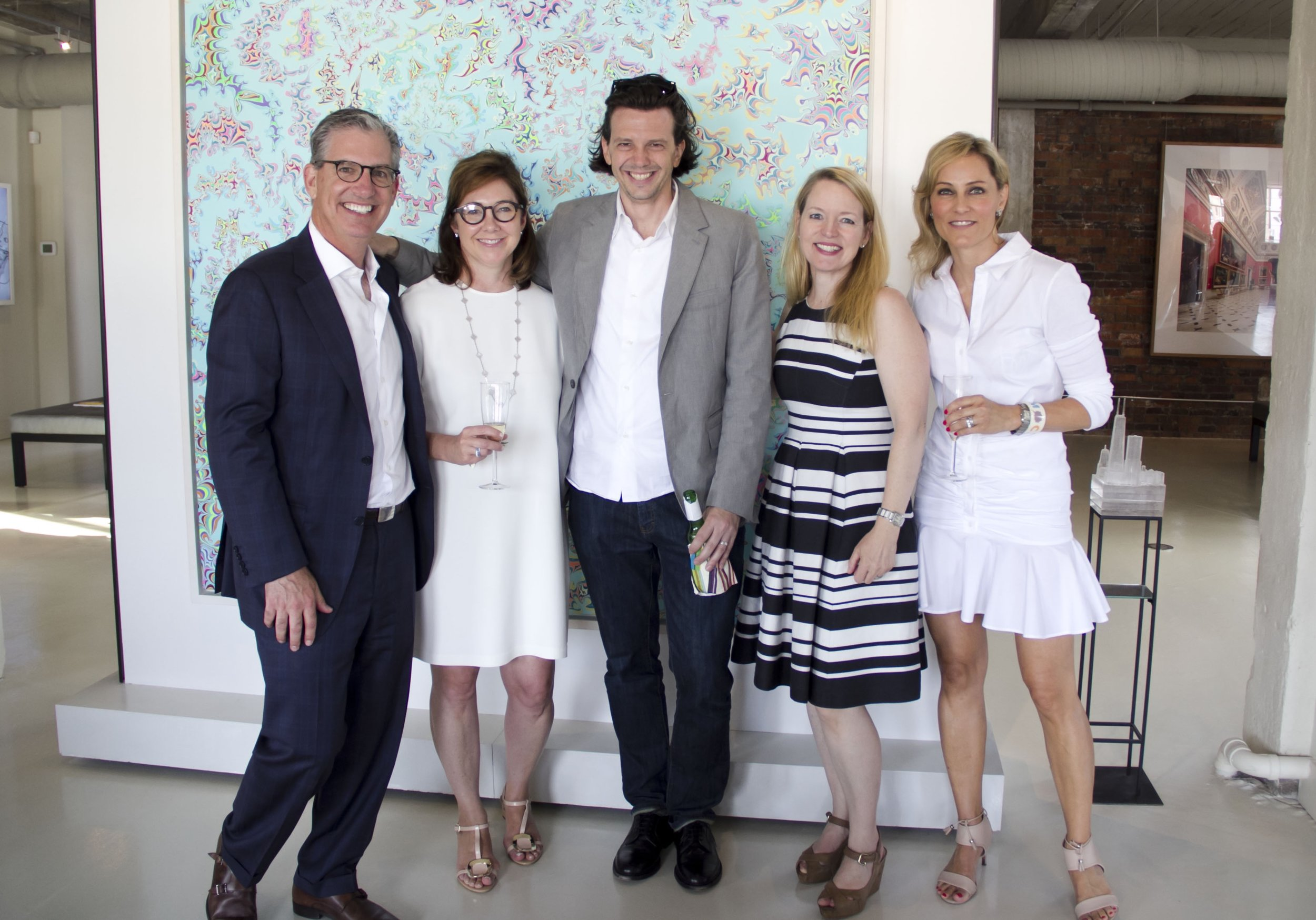 "Brother and Meredith Rutter (from Left) shown here with artist Ryan McGinness, his wife, Trish, and Larissa Trinder of CHKD to celebrate ""Energy,"" a mural designed by Ryan and installed at the CHKD Health Center at Landstown. (photography: Liz McDougall)"
