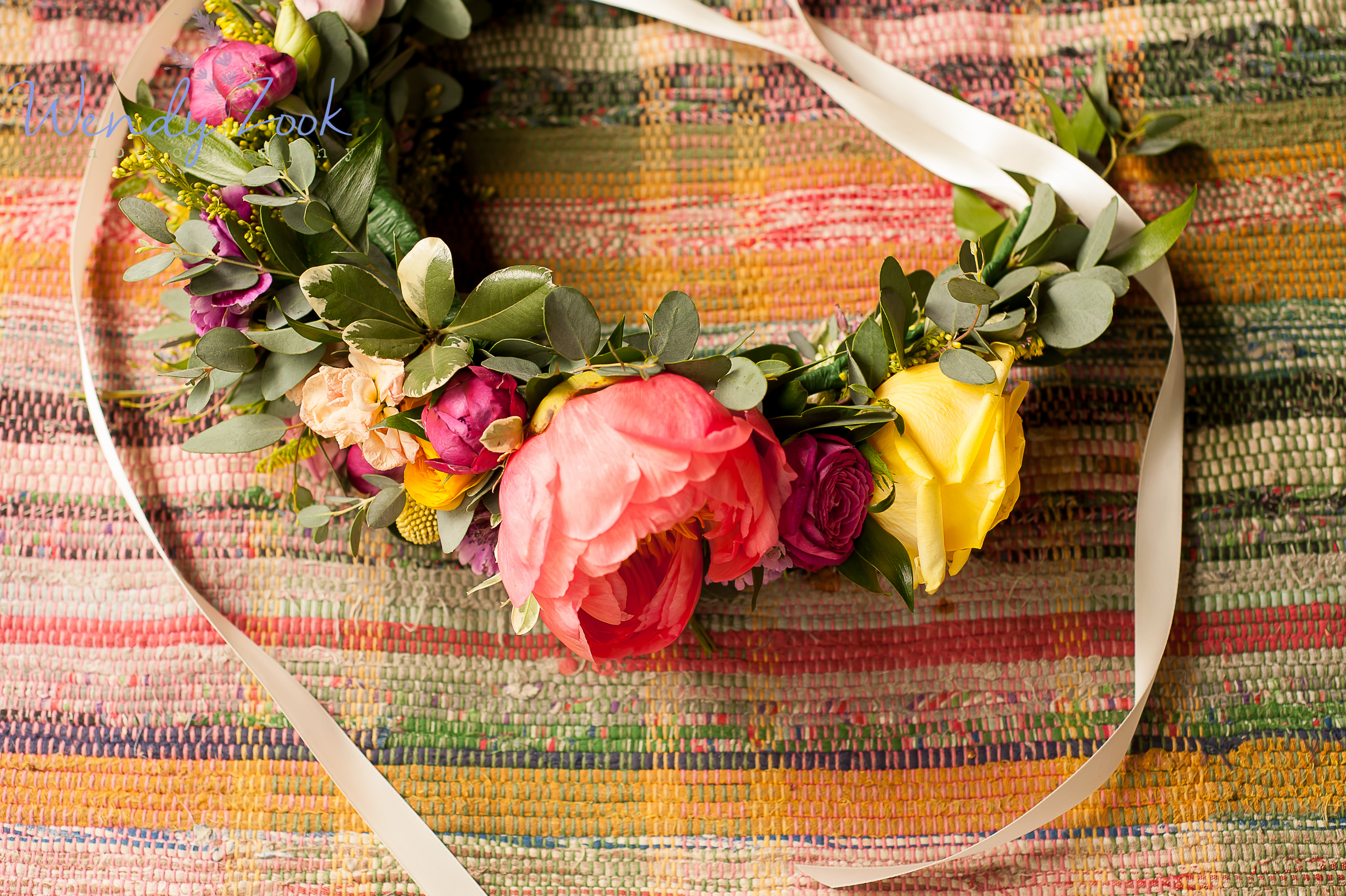 large-floral-crown-overhead-shot-on-rug-with-ribbon.jpg