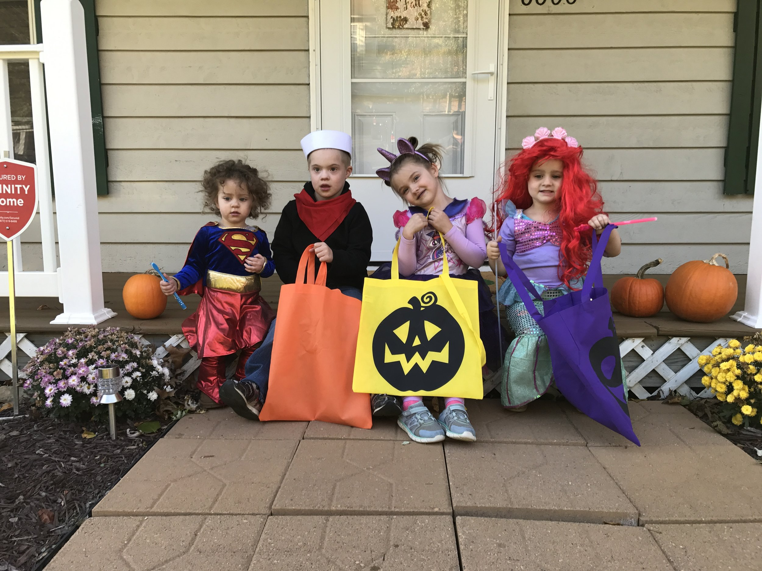 With our neighbors, new friends and Trick-orTreat team! (Zack was Popeye -- again! and Addie was Twilight Sparkle, a My Little Pony)