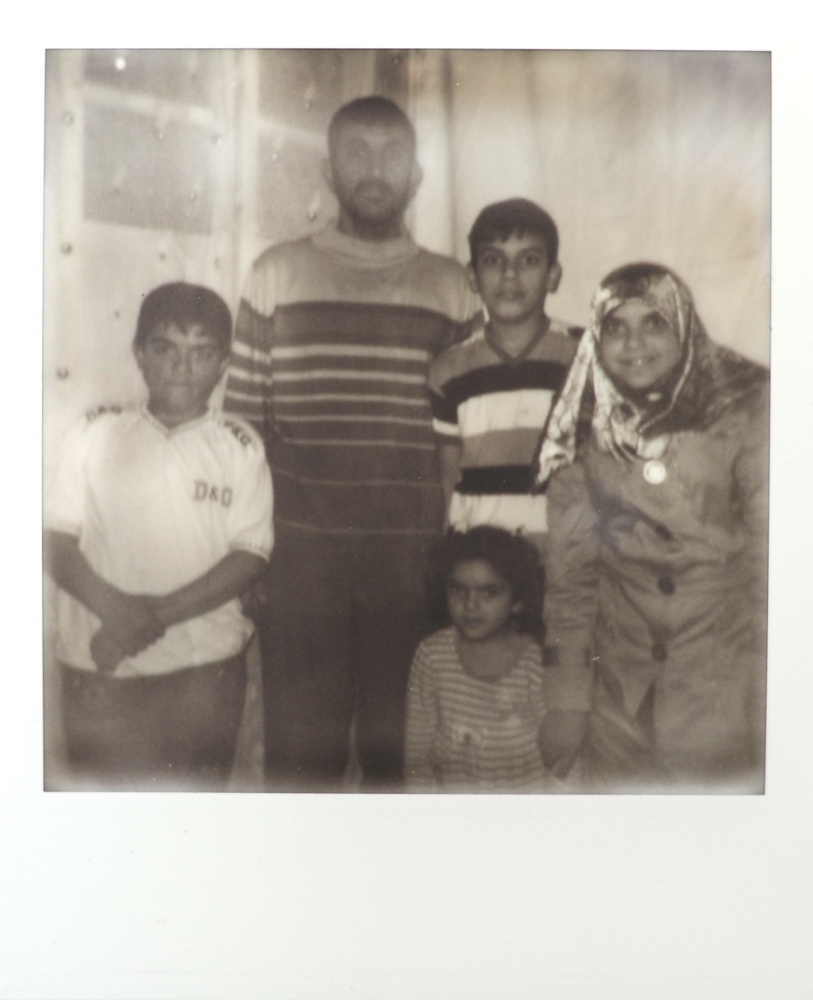 Ahmed, Mohammed, Doha, their father, and little sister stand in their apartment in Gaziantep, Turkey.   May 2014