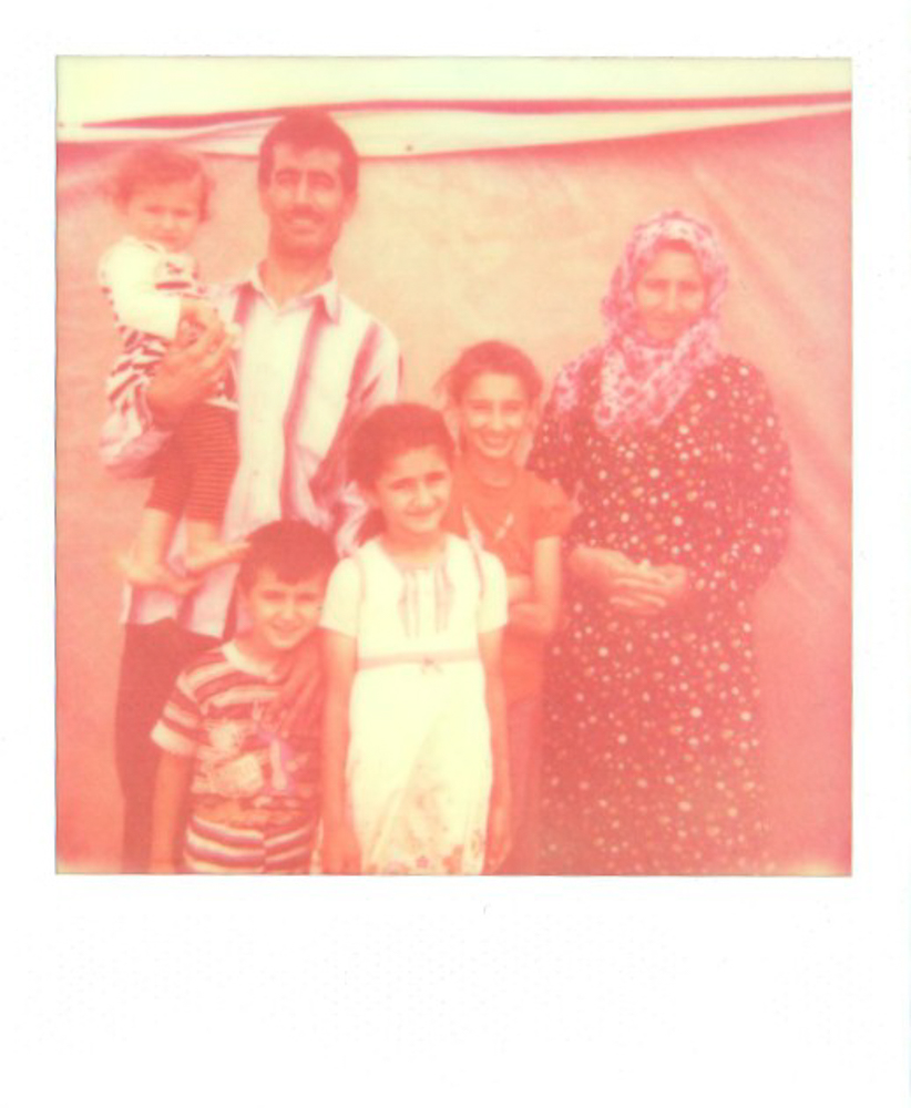 Merwa, Russia, their siblings, and parents at Kawergosk refugee camp.   July 2014
