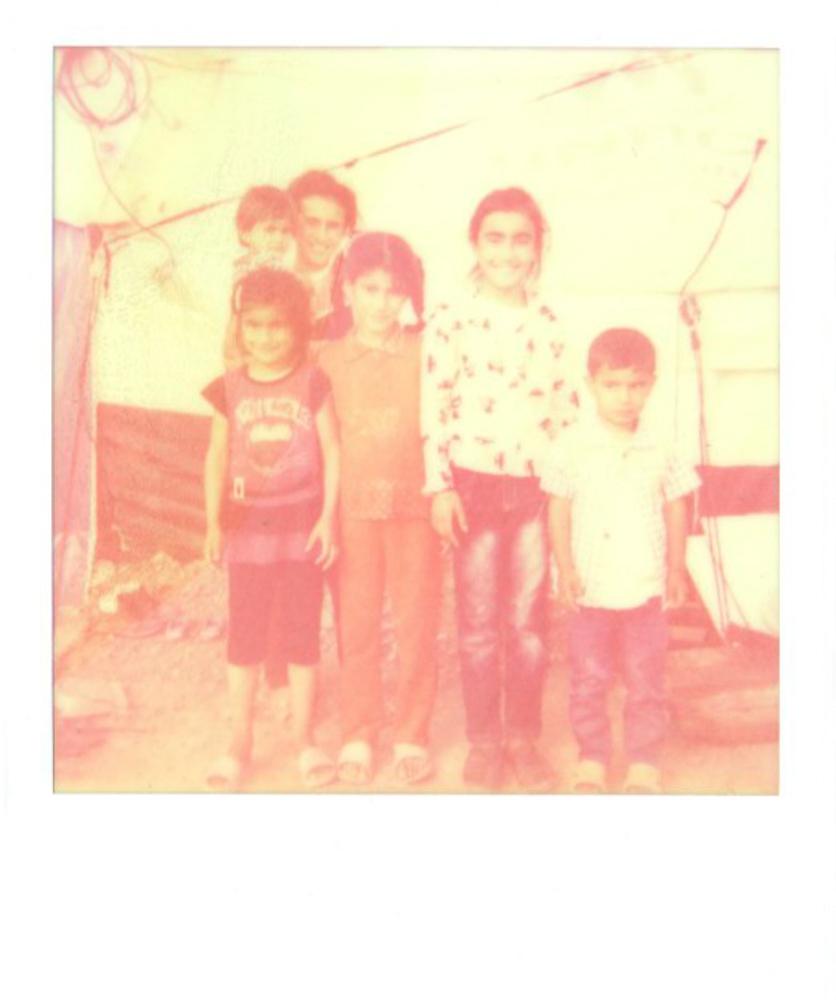 Family portrait at Kawergosk refugee camp.   July 2014