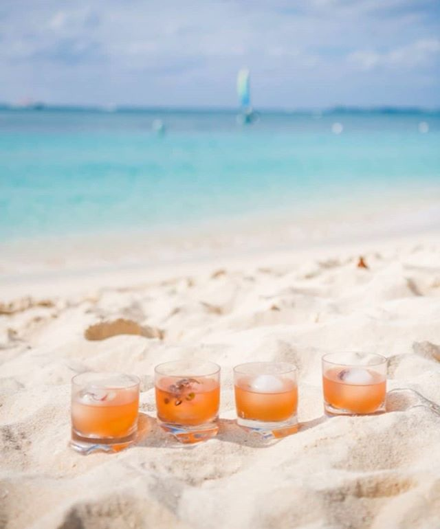 You know what we love almost as much as dipping our toes in the sand? Dipping our cold cocktails in it. We just booked our next Grand Cayman adventure for the #caymancookout #2020 @ritzcarltongrandcayman and tickets to the events go on sale next week- October 1. Mark your calendars ladies and join us for sun, fun, food and drinks on the beach! #wineandfoodevents #caribbean #islands #gcm #girlsgetaway @caymancookoutofficial #ericripert #chefjoseandres #emerillagasse #ritzcarltongrandcayman 📷@caymancookoutofficial #mybrilliantlifestyle #lifebydesign