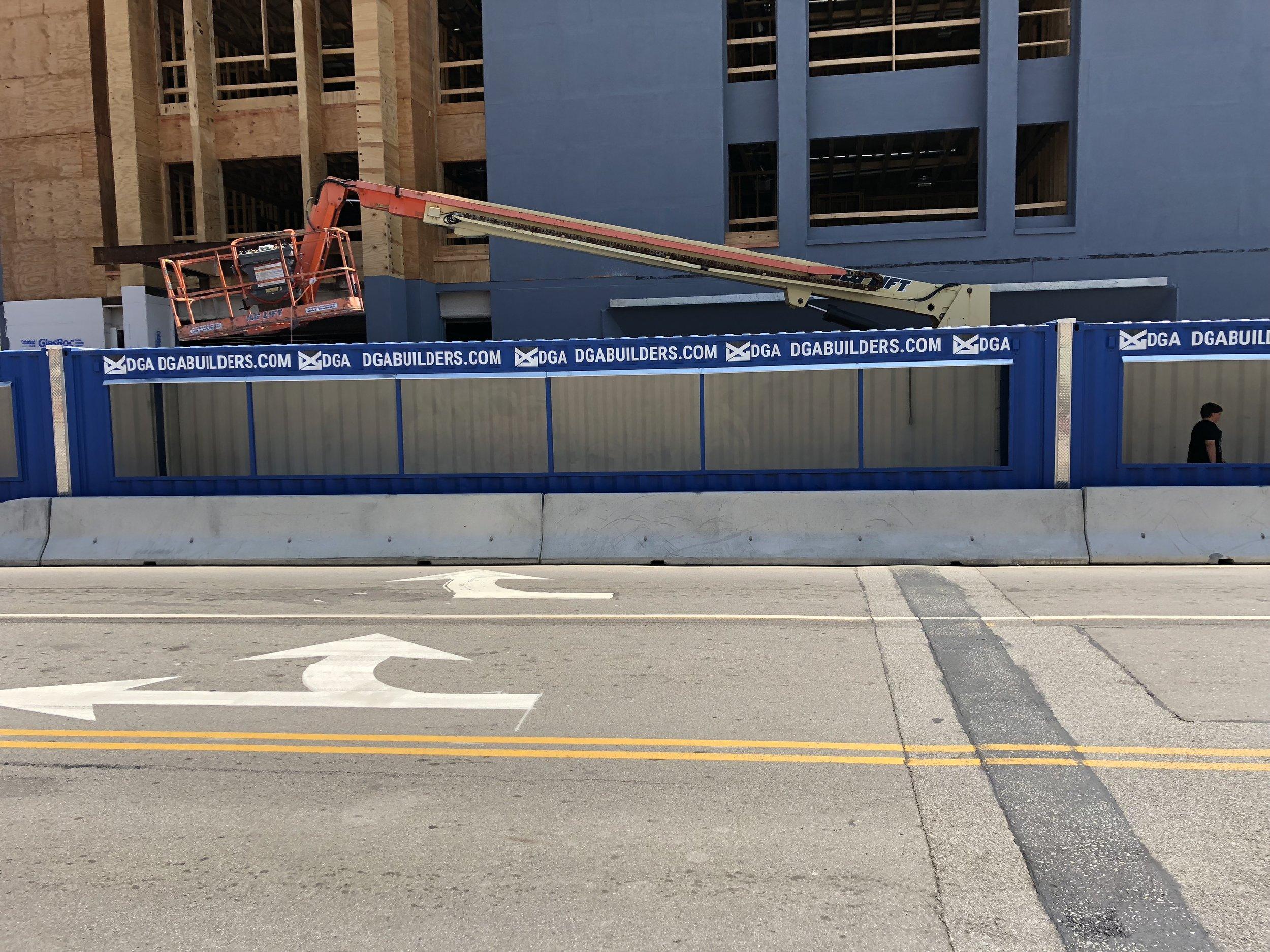 Custom Signage for DGA's Construction site next to Dinosaur BBQ