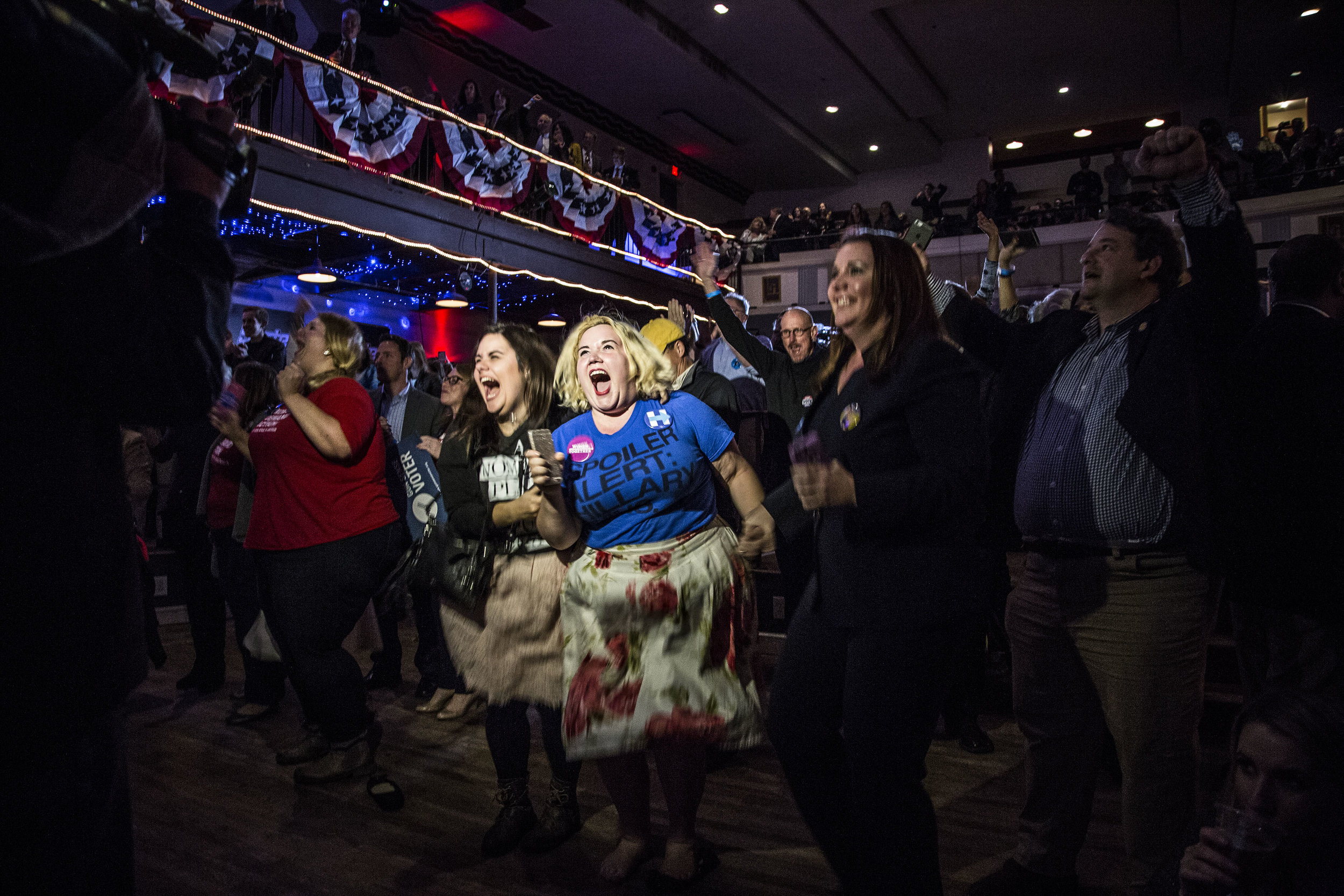 Hillary Clinton supporters react to early election results during Governor Terry McAuliffe's election night watch party in Falls Church, Va.