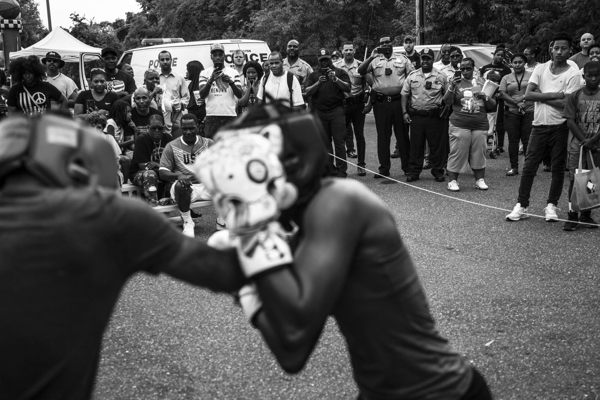 Tiara spars against a teammate in an exhibition fight during the Metropolitan Police Dept.'s National Night Out, an event that promotes police-community bonding.