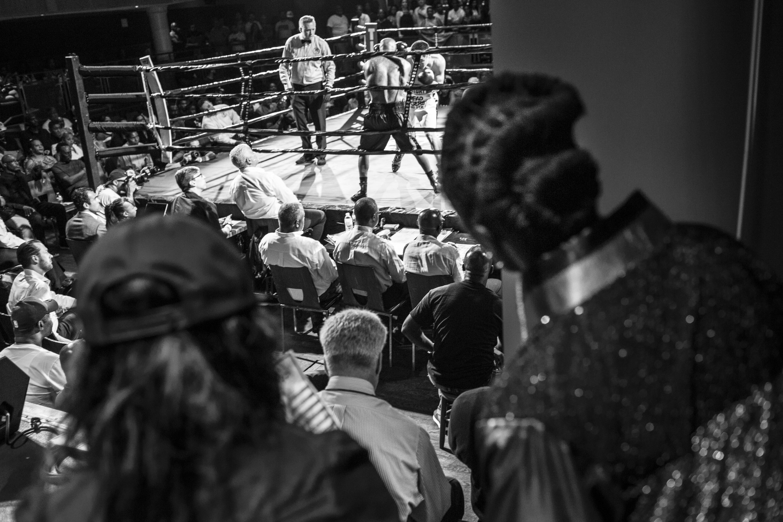 Tiara looks on as her teammate fights at the Howard Theatre in downtown DC, the same night she had her second knockout win as a pro fighter.