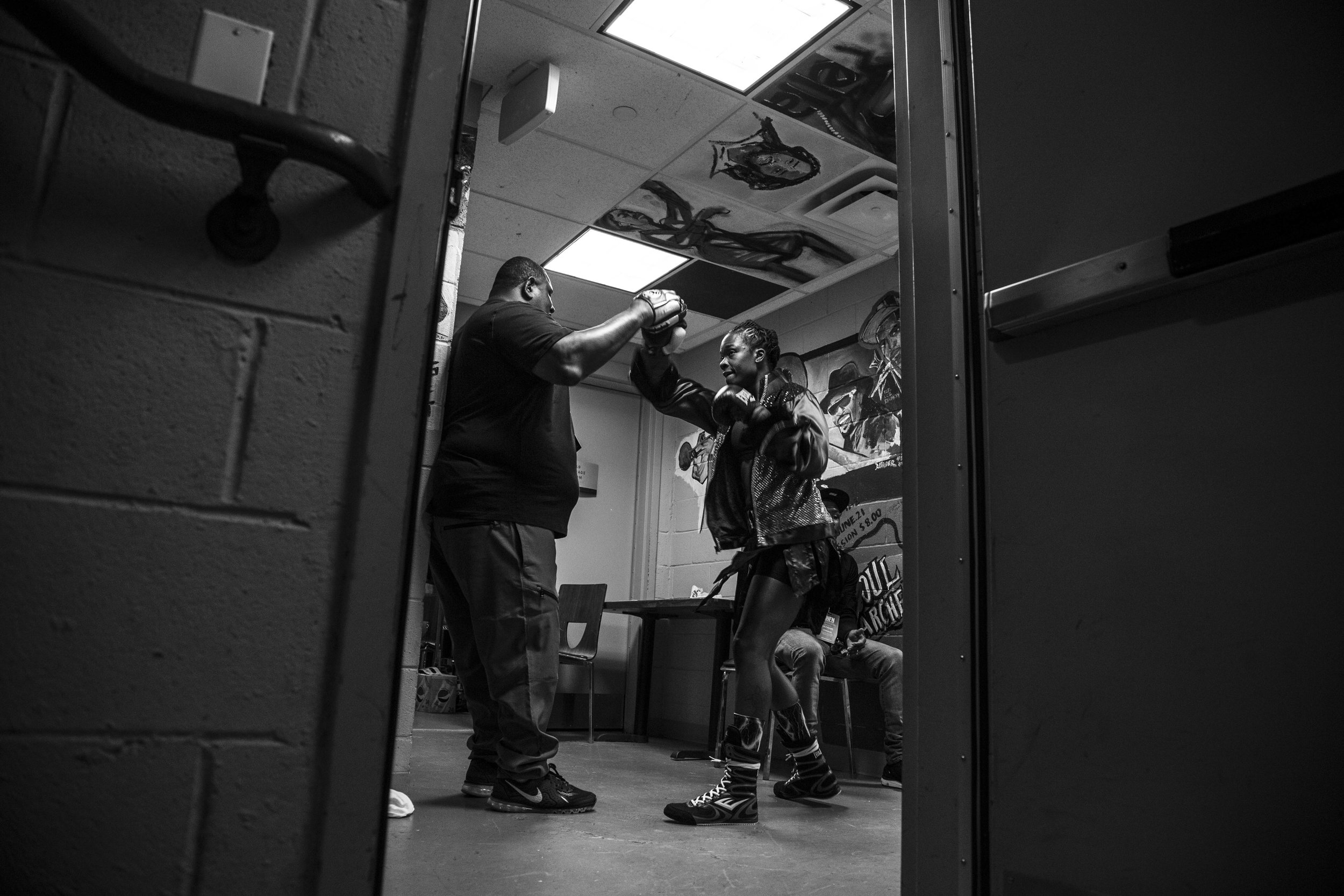 "Tiara warms up with coach Patrick ""Boogie"" Harris at the Howard Theatre in downtown DC, before her third pro fight."