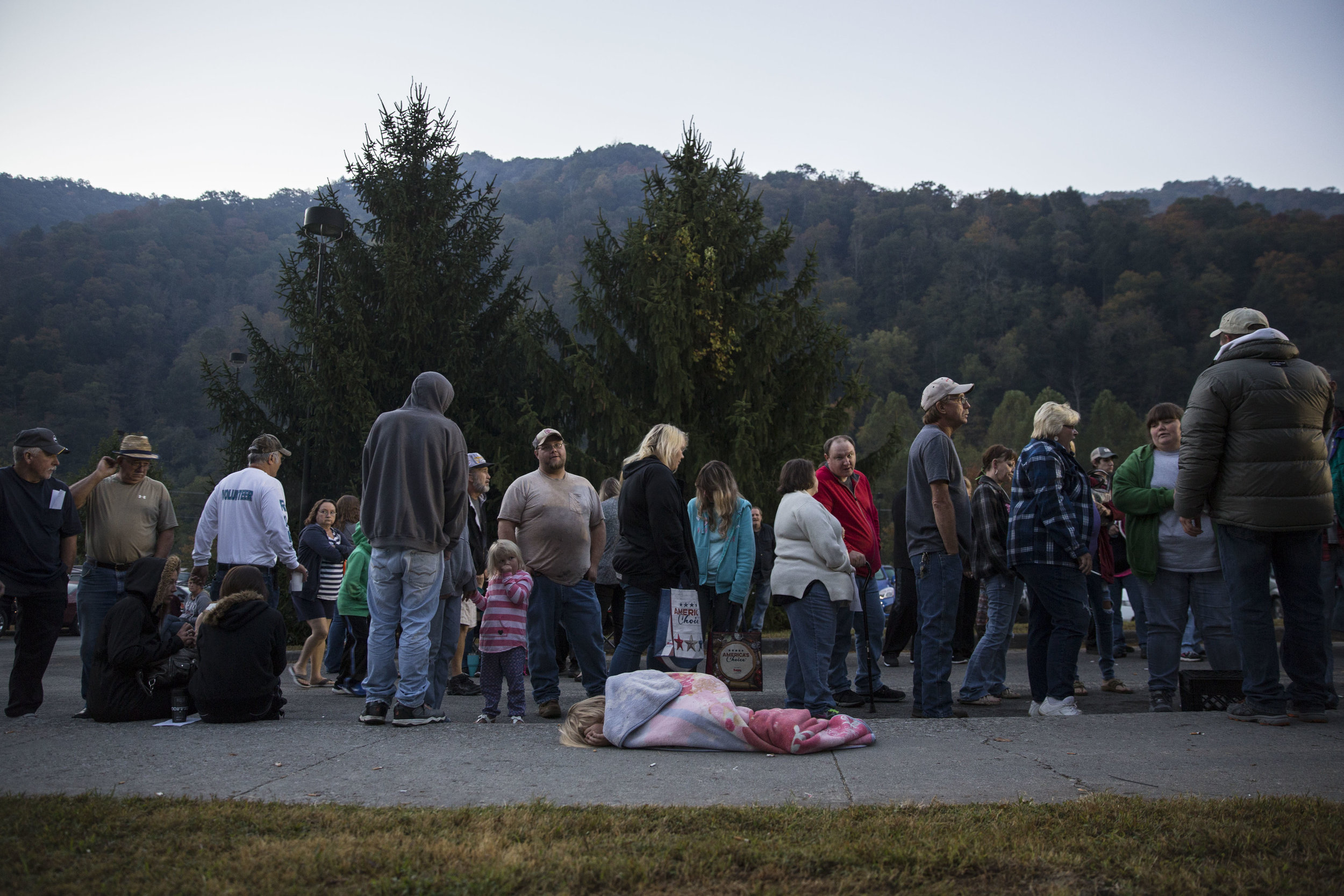 People wait to enter the Remote Area Medical (RAM) mobile clinic in Grundy, Virginia, which provided free general health services to uninsured and underinsured people in remote areas of the US.