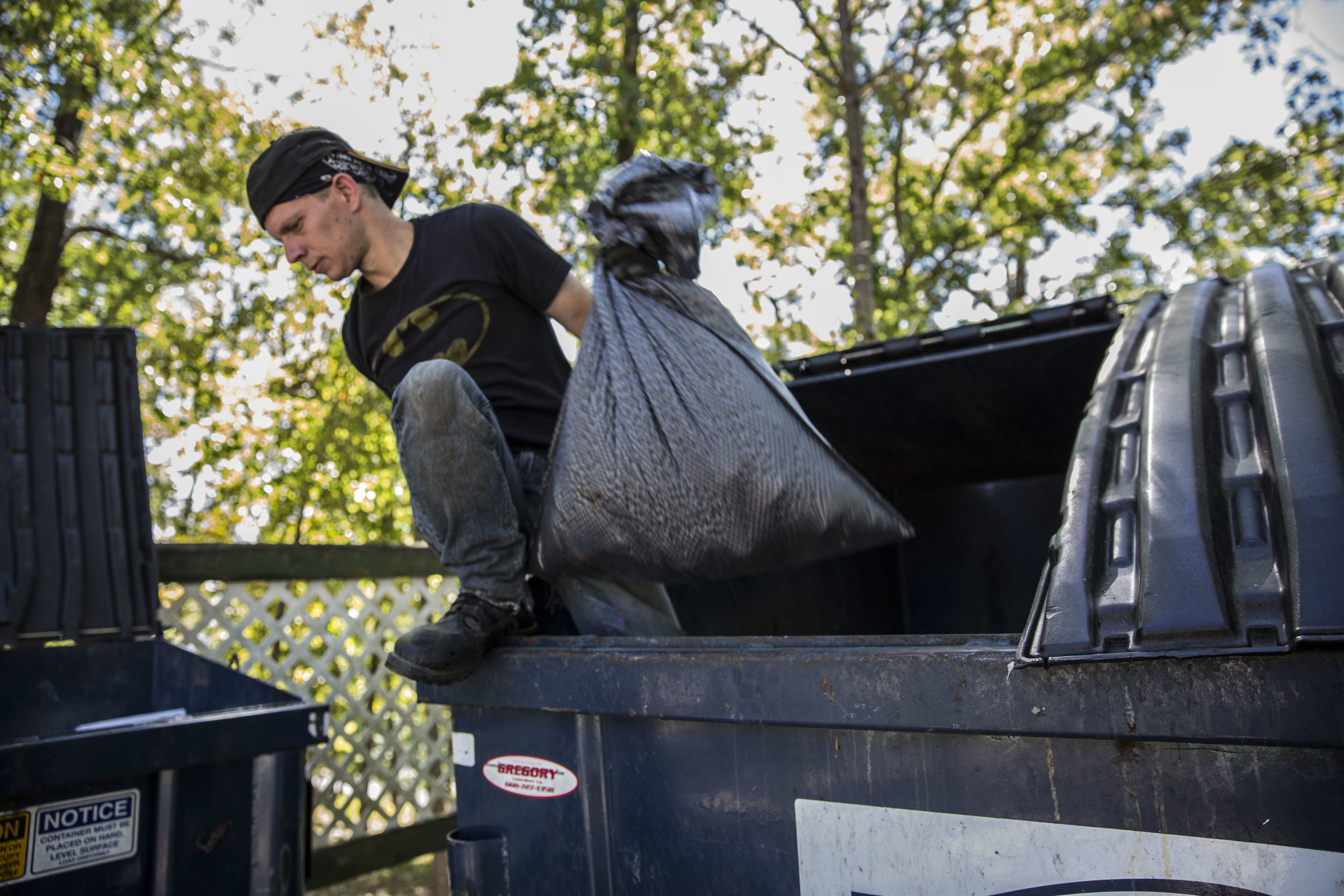 "Chris dumpster dives looking for metal scraps and useful items. Currently unemployed, he manages to make some income from scrapping, which would make him roughly $23 a day. ""I don't go stealing like some of these kids. If I have to go without eating for a few days, I will."""