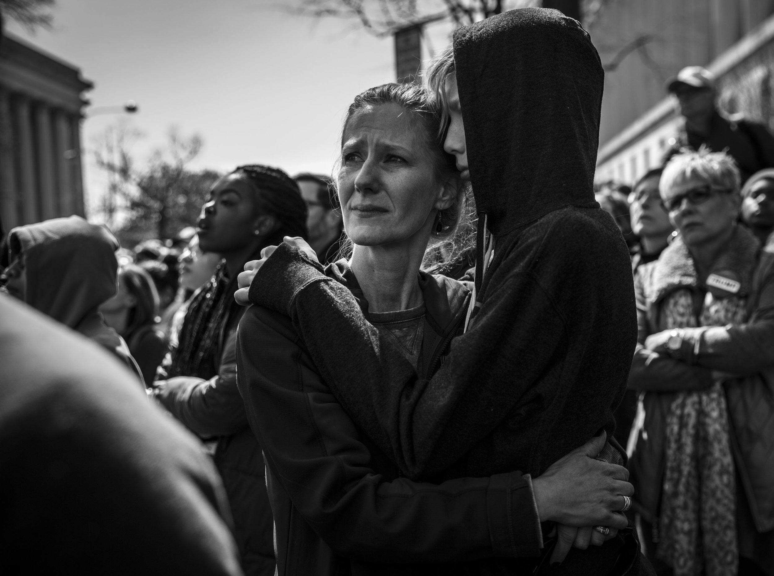 A woman embraces a child during the March For Our Lives in Washington, DC.