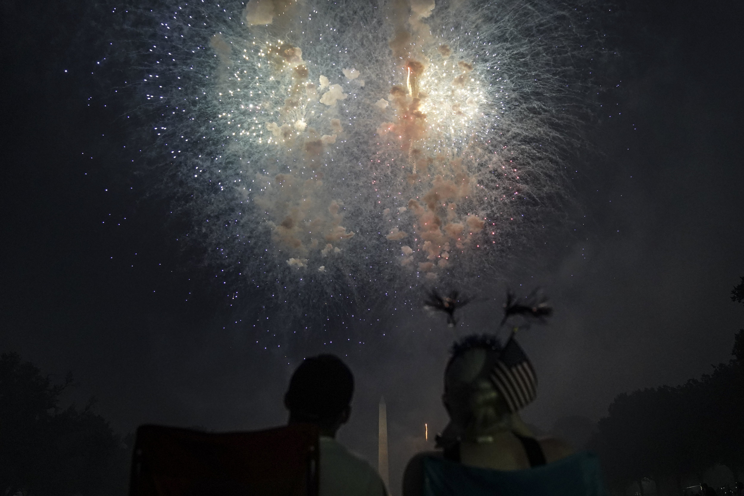 People watch fireworks during the 4th of July Independence Day celebrations at the National Mall in Washington.